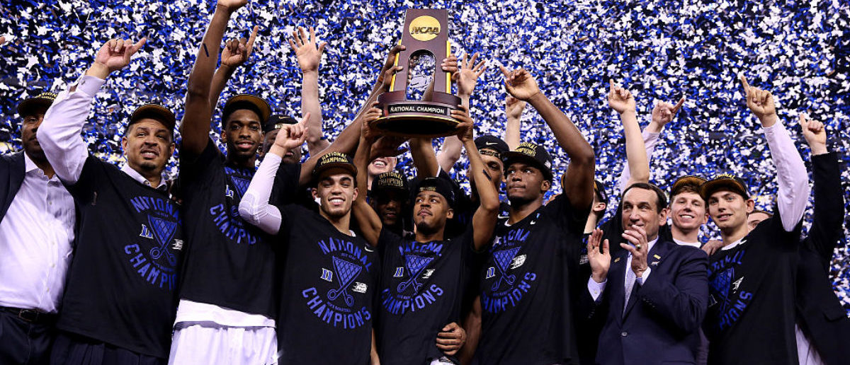 INDIANAPOLIS, IN - APRIL 06: The Duke Blue Devils celebrate with the championship trophy after defeating the Wisconsin Badgers during the NCAA Men's Final Four National Championship at Lucas Oil Stadium on April 6, 2015 in Indianapolis, Indiana. Duke defeated Wisconsin 68-63. (Photo by Streeter Lecka/Getty Images)