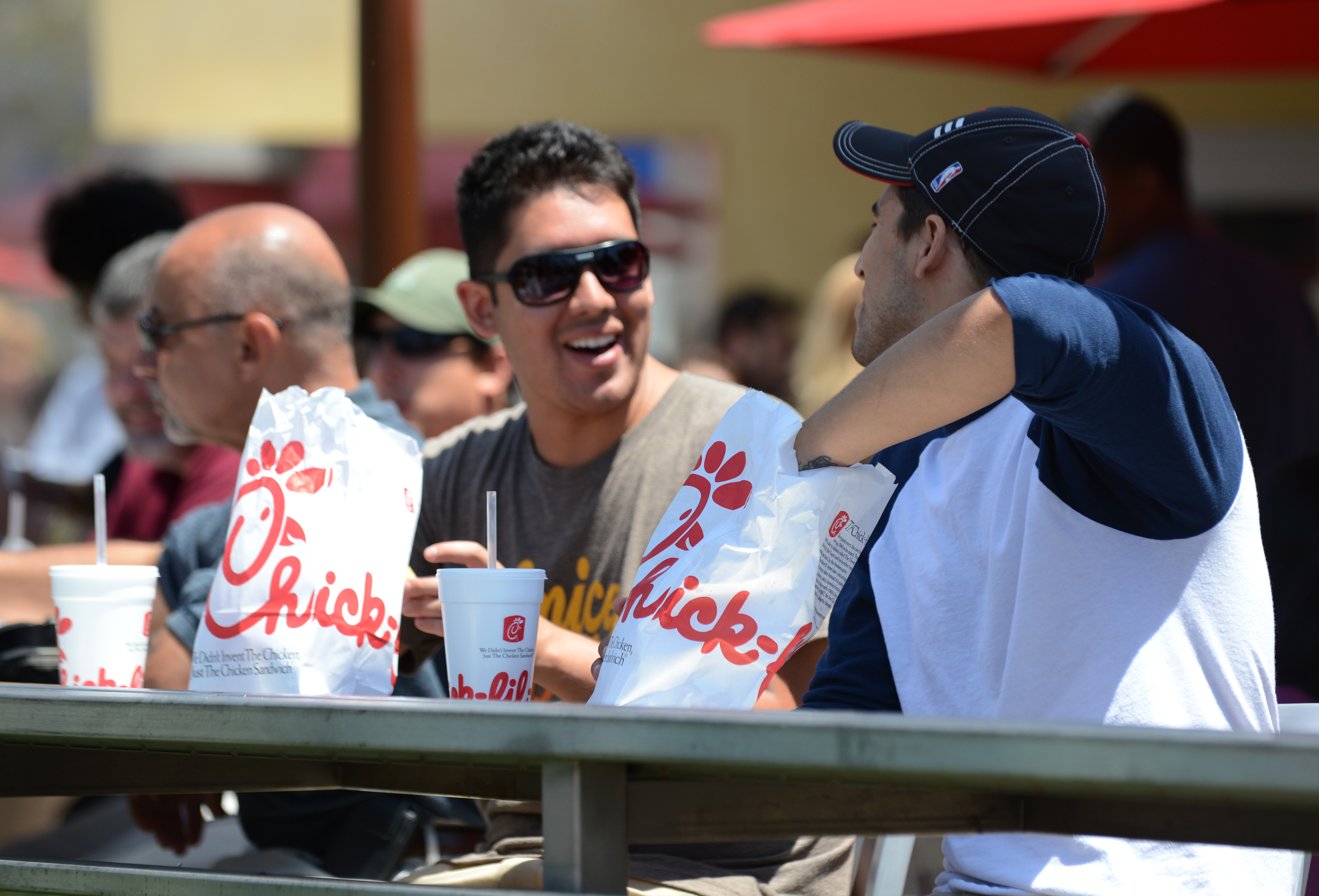 Two men prepare to have lunch on the patio of the Chick-fil-A in Hollywood, California, August 1, 2012. (ROBYN BECK/AFP/GettyImages)