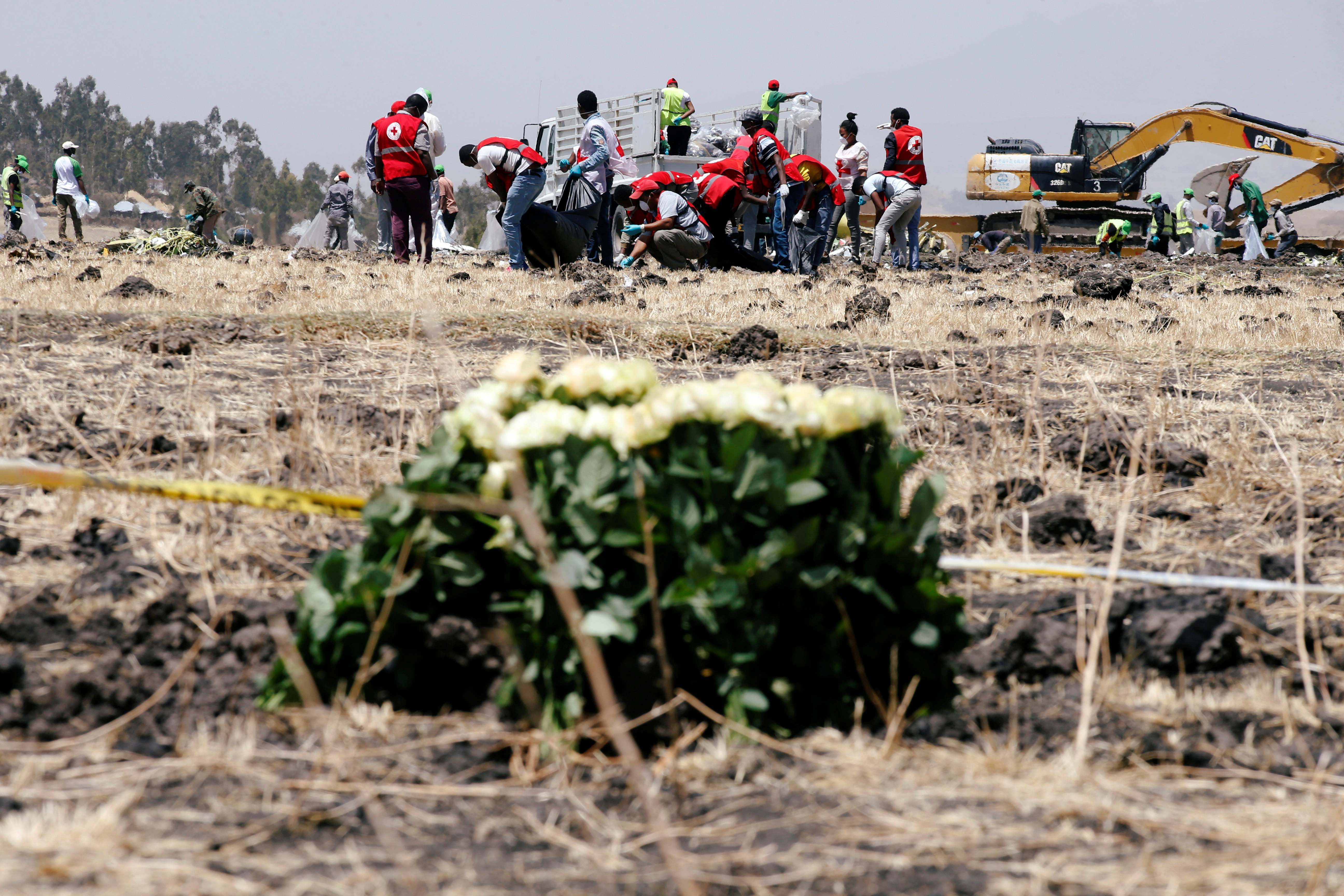 Members of the Ethiopian red cross search for remains at the Ethiopian Airlines Flight ET 302 plane crash before a commemoration ceremony at the scene of the crash, near the town of Bishoftu, southeast of Addis Ababa, Ethiopia March 13, 2019. REUTERS/Baz Ratner