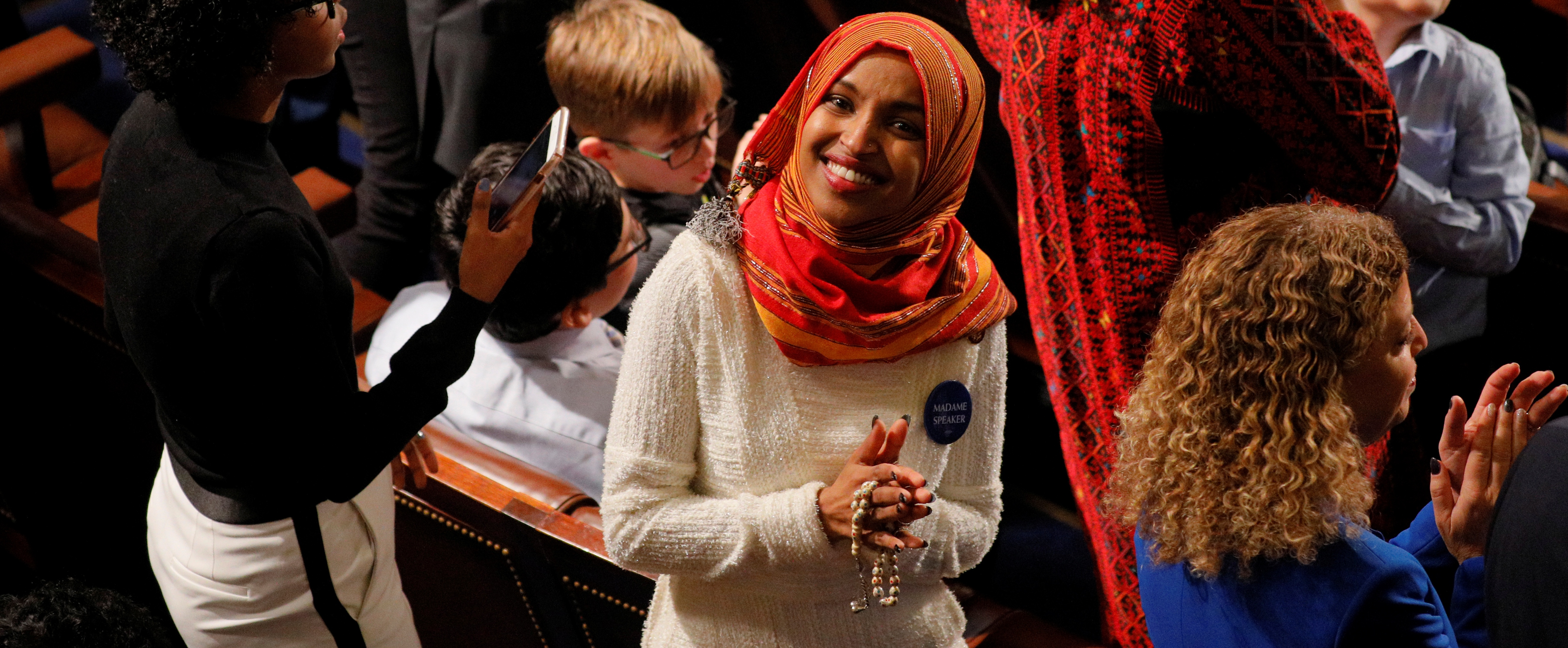 U.S. Rep.-elect Ilhan Omar (D-MN) smiles from the floor of the U.S. House of Representatives before being sworn in to the new Congress at the U.S. Capitol in Washington, U.S., January 3, 2019. REUTERS/Brian Snyder