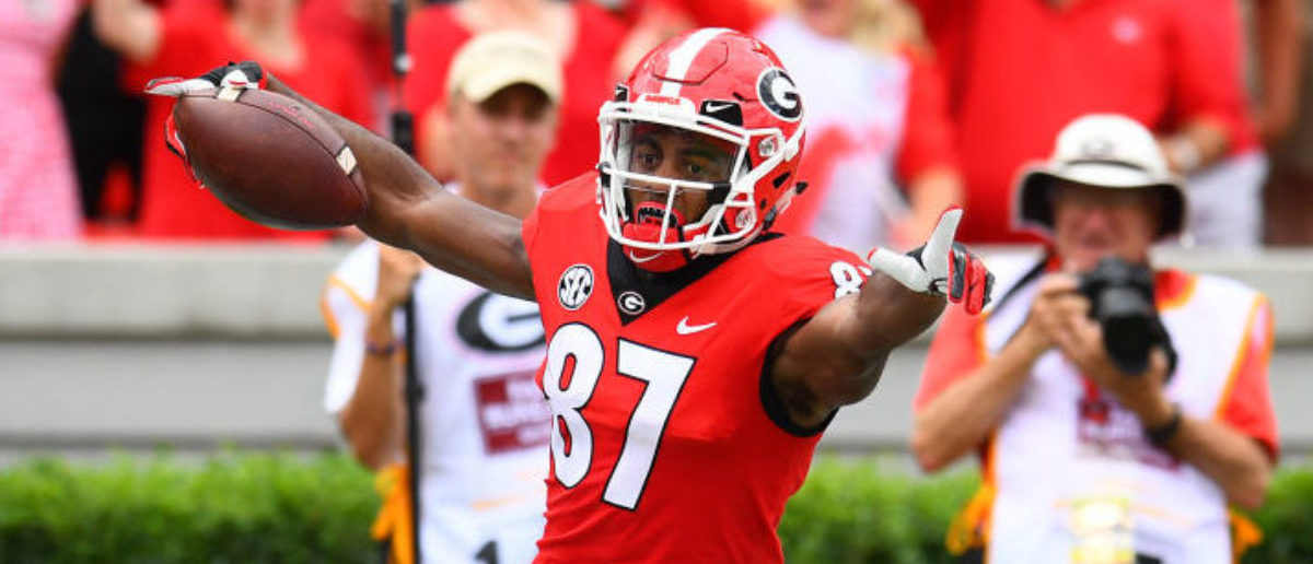 ATHENS, GA - SEPTEMBER 15: Tyler Simmons #87 of the Georgia Bulldogs celebrates after scoring a touchdown on a 56 yard carry against the Middle Tennessee Blue Raiders on September 15, 2018 at Sanford Stadium in Athens, Georgia. (Photo by Scott Cunningham/Getty Images)