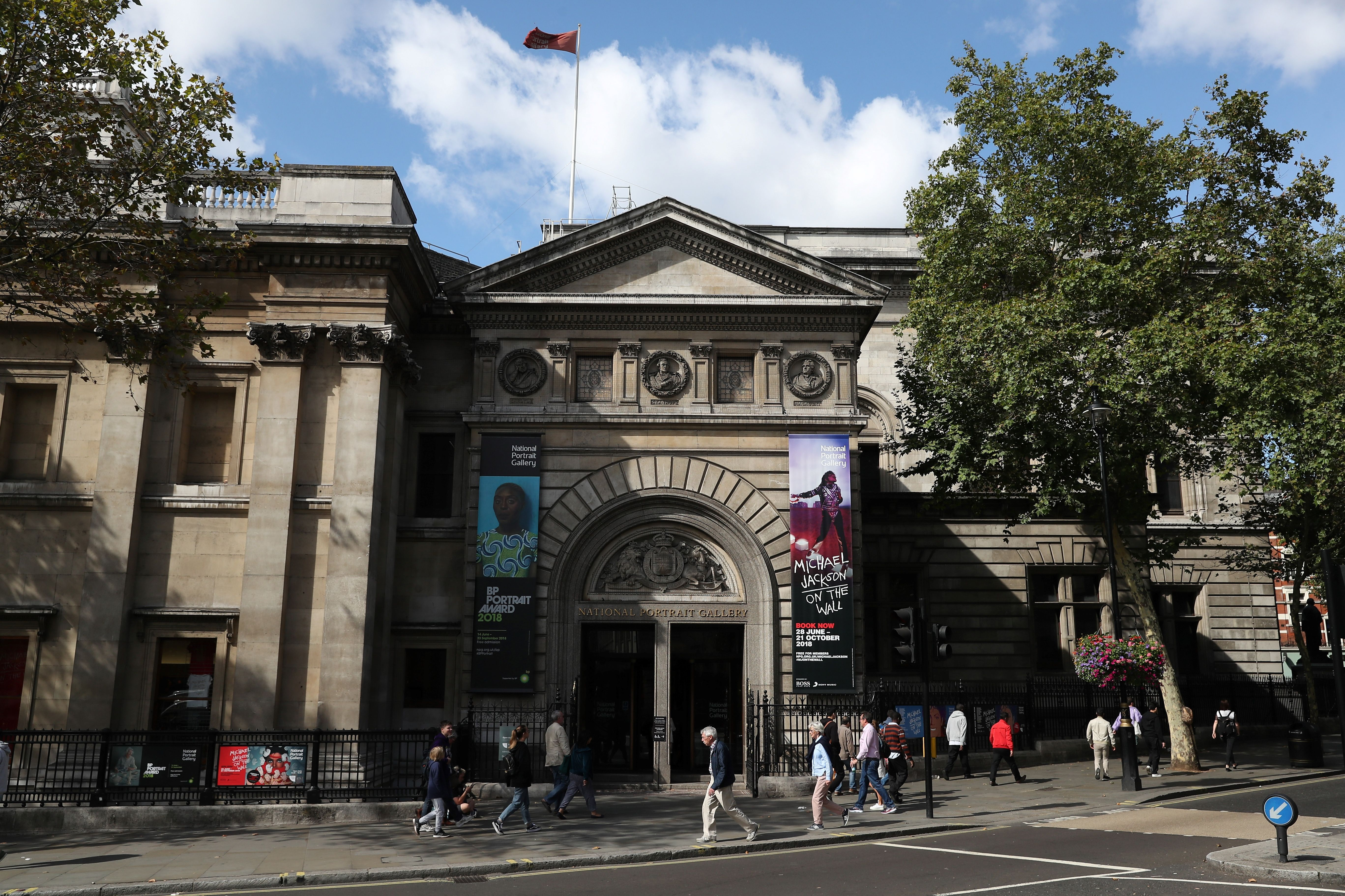 Pedestrians walk past the entrance to the National Portrait Gallery in central London on August 24, 2018. (DANIEL LEAL-OLIVAS/AFP/Getty Images)