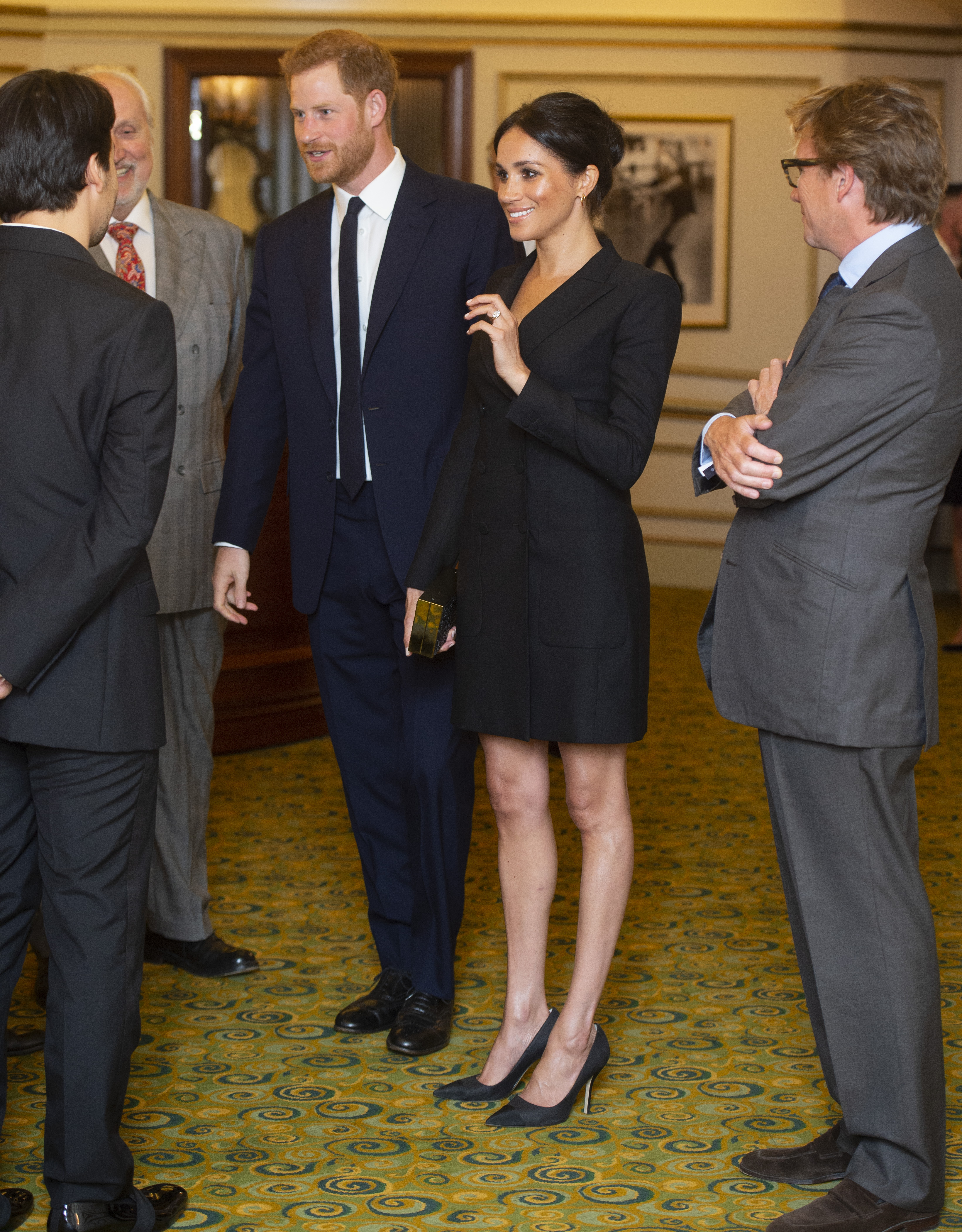 """Prince Harry, Duke of Sussex and Meghan, Duchess of Sussex speak with writer Lin Manuel Miranda and others from Sentibale as they attend a gala performance of """"Hamilton"""" in support of Sentebale at Victoria Palace Theatre on August 29, 2018 in London, England. (Photo by Dan Charity - WPA Pool/Getty Images)"""
