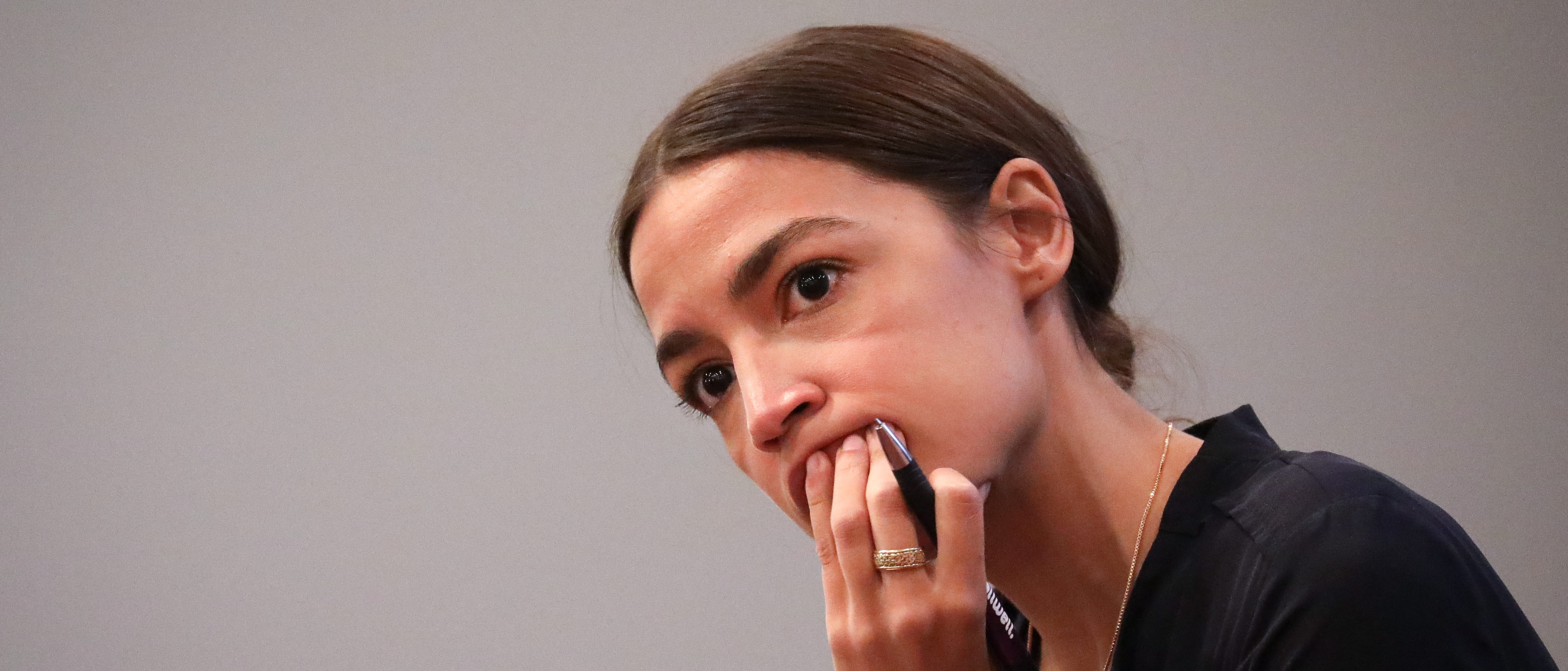 NEW YORK, NY - SEPTEMBER 19: Alexandria Ocasio-Cortez, Democratic candidate running for New York's 14th Congressional district, listens to questions at a town hall event, September 19, 2018 in The Bronx borough of New York City. In a race she is widely expected to win, Ocasio-Cortez will face Republican nominee Anthony Pappas in the November 6 general election. (Photo by Drew Angerer/Getty Images)