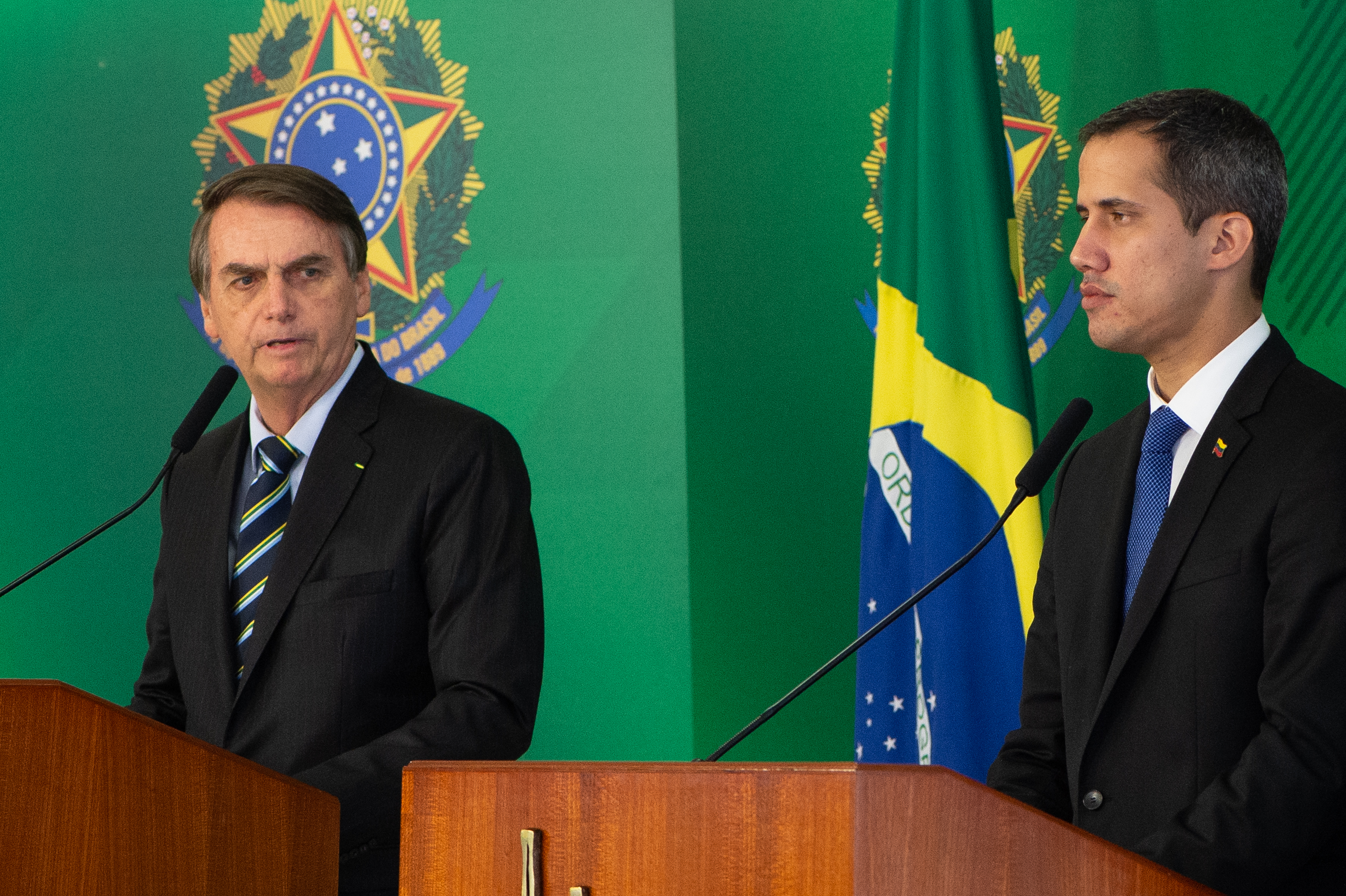 Venezuelan opposition leader and self-declared iterim president Juan Guaido and Brazilian President Jair Bolsonaro speak during a press conference at Palace Itamaraty on February 28, 2019 in Brasília, Brazil. (Photo by Andressa Anholete/Getty Images)