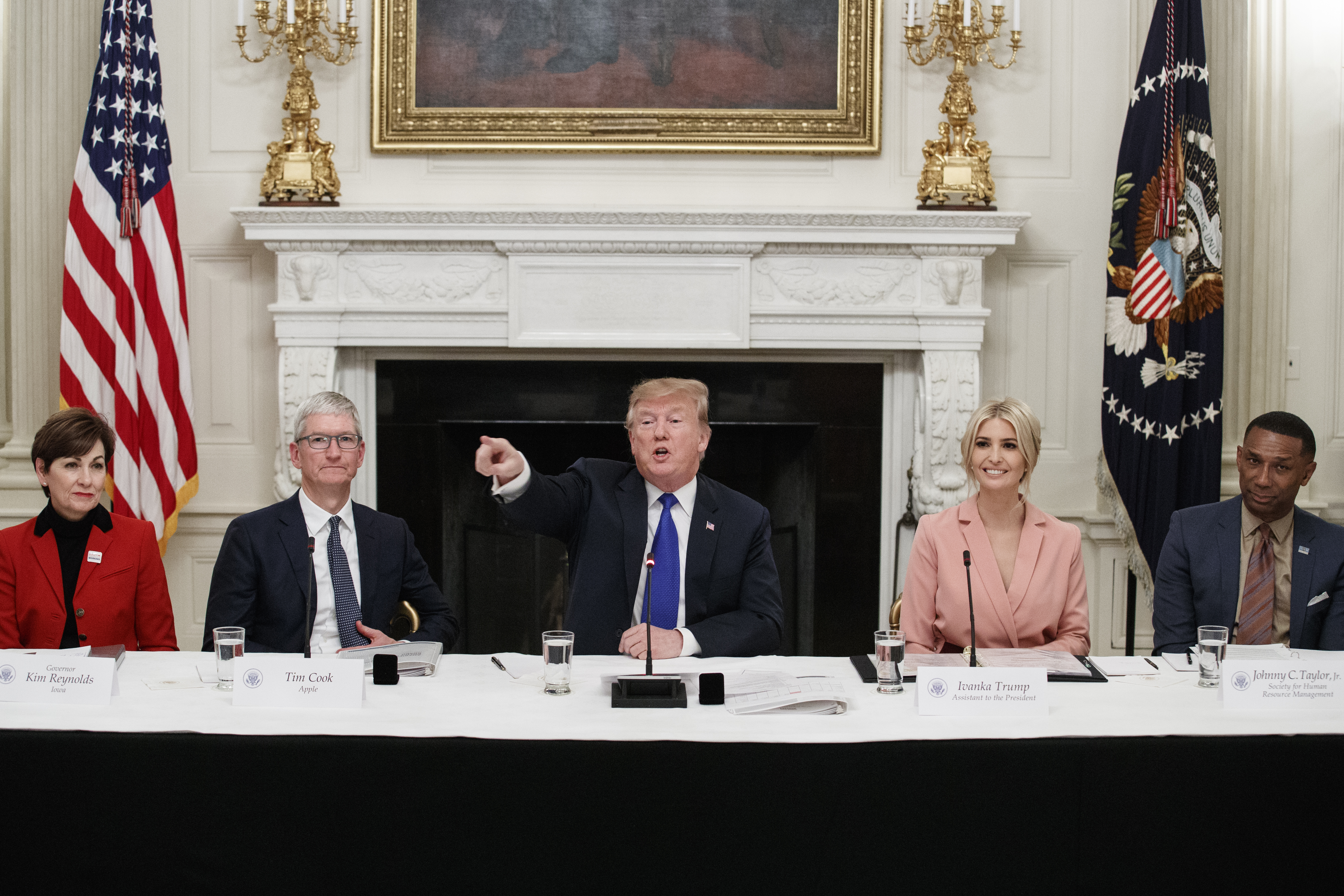 President Donald Trump delivers remarks beside Iowa Governor Kim Reynolds, far left, Apple CEO Tim Cook, left, Advisor Ivanka Trump, right, and Johnny C. Taylor, Jr., CEO of the Society for Human Resource Management, far right, during a meeting with the American Workforce Policy Advisory Board inside the State Dining Room of the White House on March 6, 2019 in Washington, DC. (Photo by Tom Brenner/Getty Images)