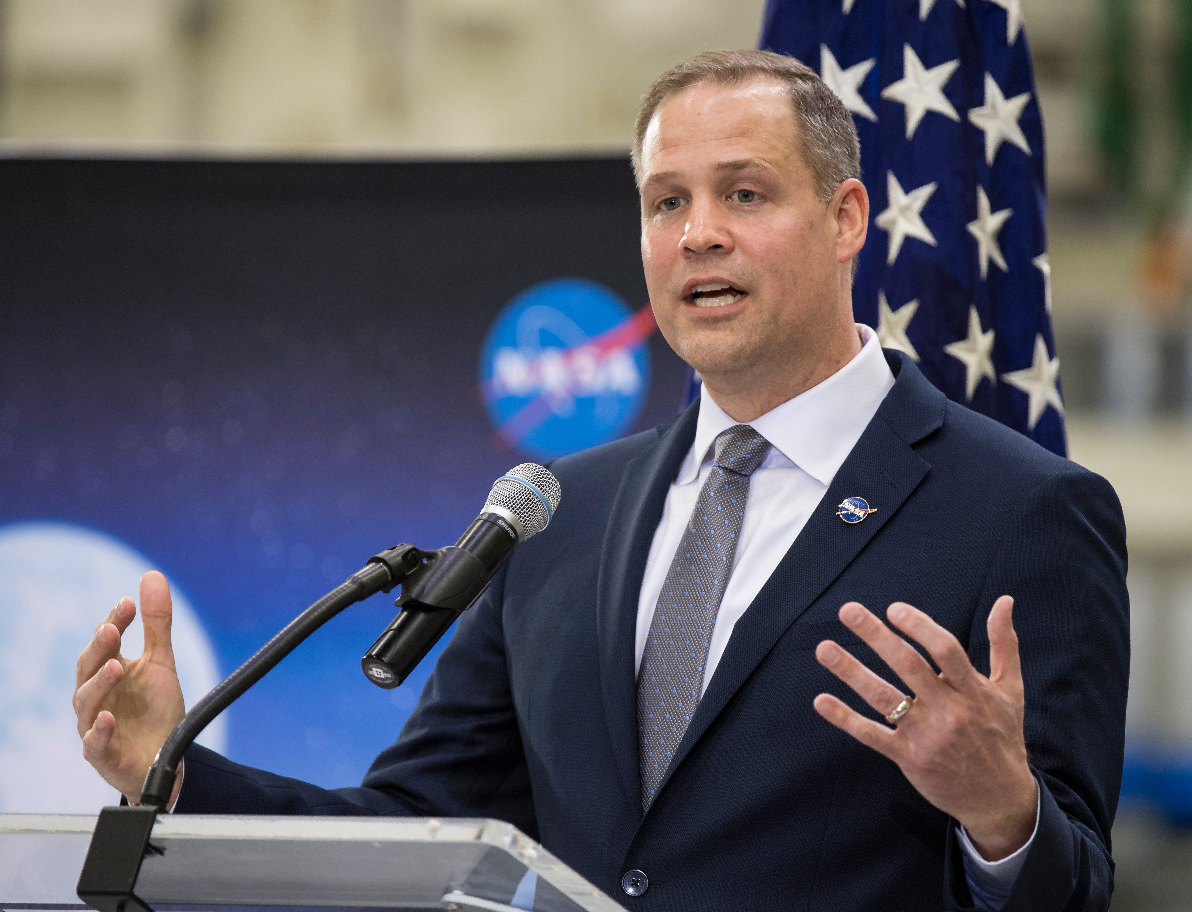 CAPE CANAVERAL, FL - MARCH 11: In this handout photo provided by NASA, NASA Administrator Jim Bridenstine talks to employees about the agencys progress toward sending astronauts to the Moon and on to Mars during a televised event at the Neil Armstrong Operations and Checkout Building at NASA's Kennedy Space Center on March 11, 2019 in Cape Canaveral, Florida. (Aubrey Gemignani/NASA via Getty Images)