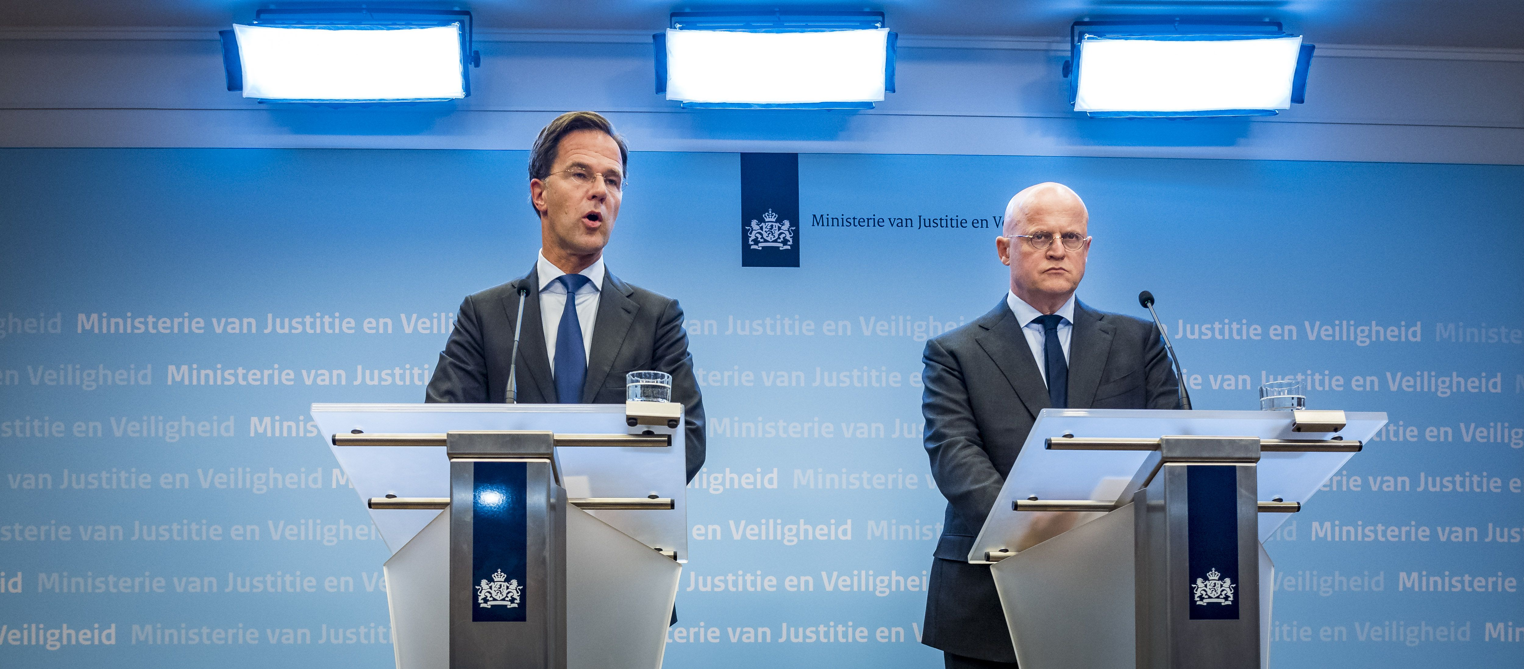 Dutch Prime Minister Mark Rutte (L) and Right, Justice and Security Minister Ferd Grapperhaus speak to the press at the Ministry of Justice and Security in The Hague, on March 18, 2019 following a shooting in a tram in Utrecht. (LEX VAN LIESHOUT/AFP/Getty Images)