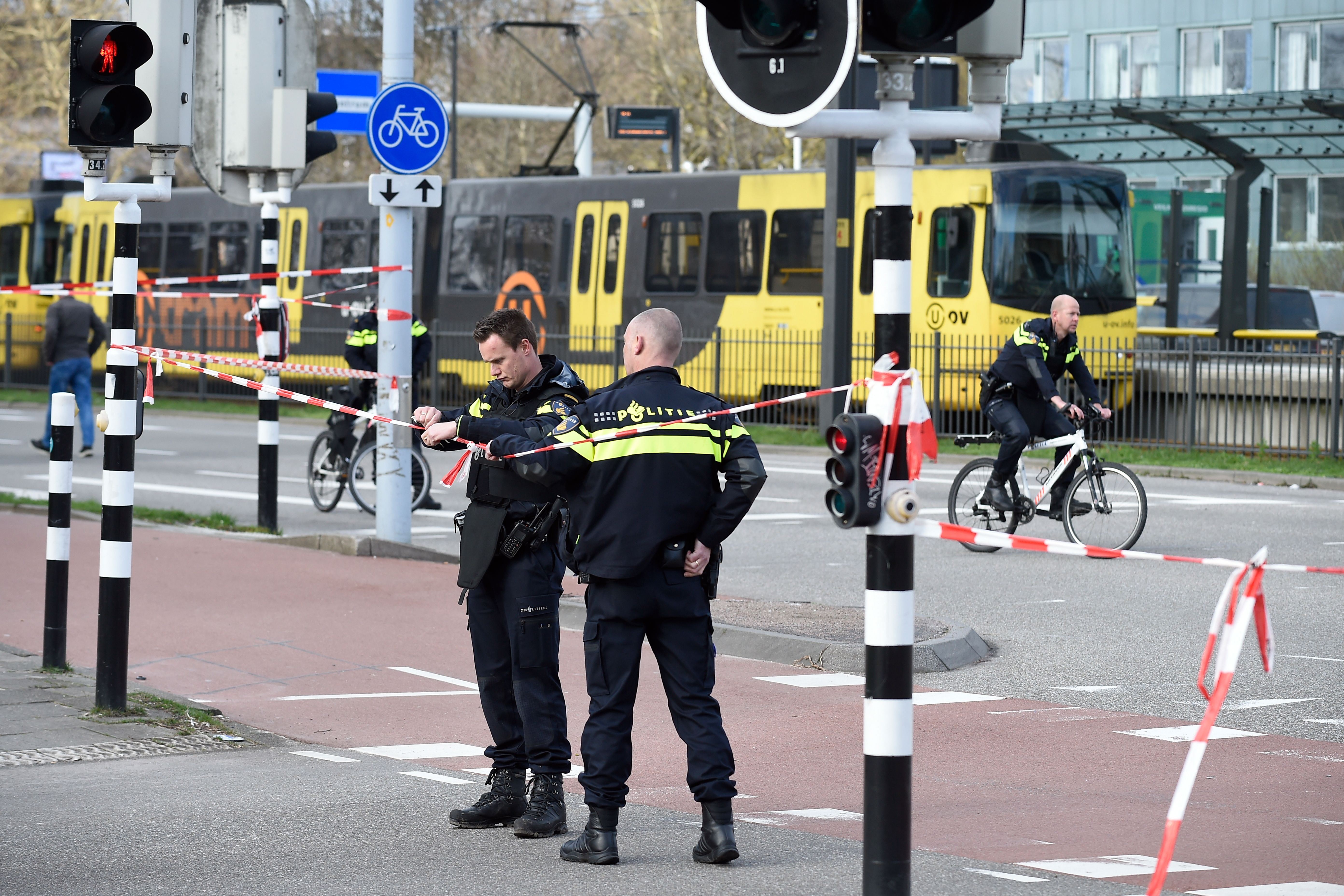 Policemen are at work on March 18, 2019 in Utrecht, near a tram where a gunman opened fire killing at least three persons and wounding several in what officials said was a possible terrorist incident. (JOHN THYS/AFP/Getty Images)