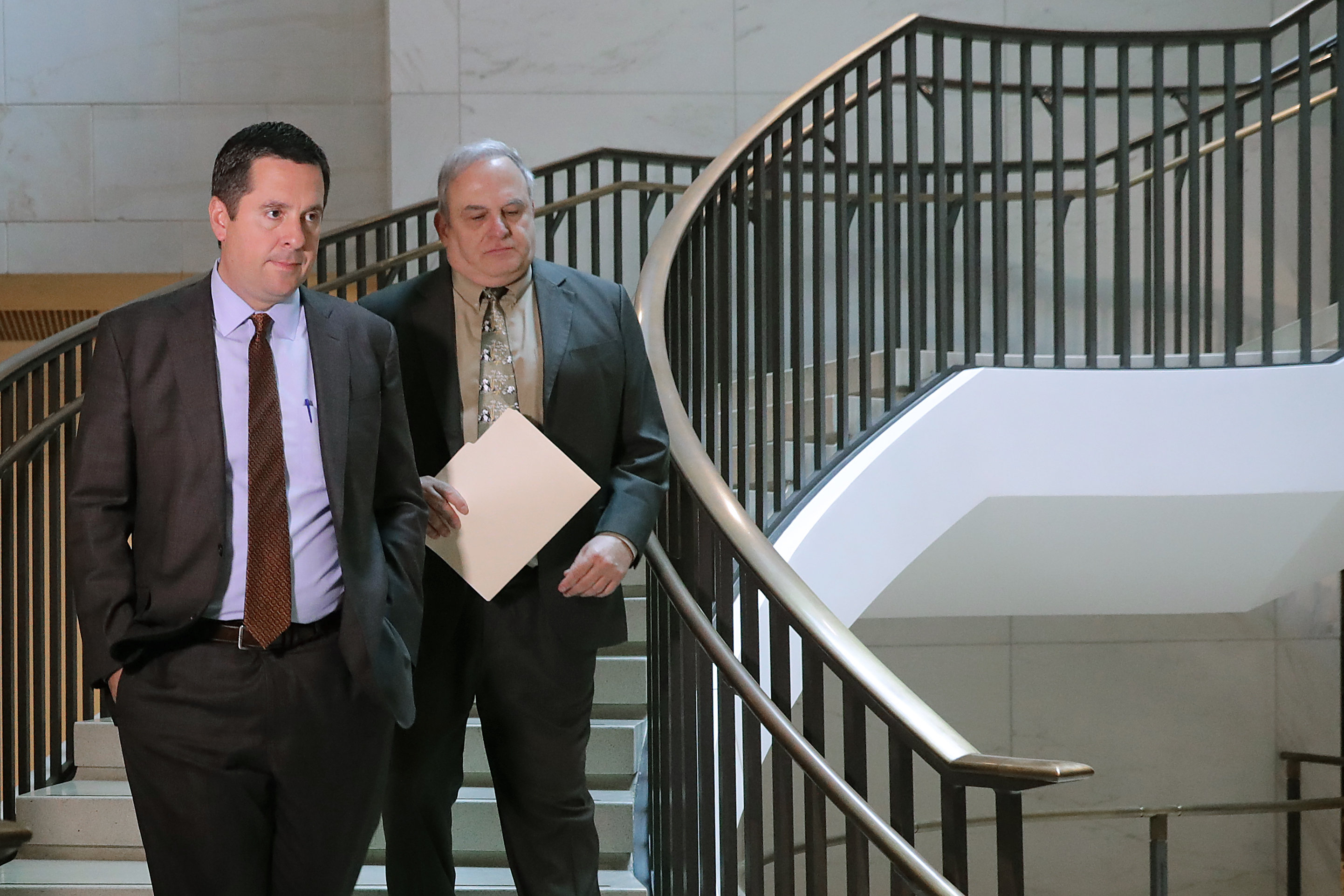 House Intelligence Committee ranking member Rep. Devin Nunes (L) arrives for a closed-door hearing with Michael Cohen, former attorney and fixer for President Donald Trump, in the basement of the House Visitors Center at the U.S. Capitol March 06, 2019 in Washington, DC. (Photo by Chip Somodevilla/Getty Images)