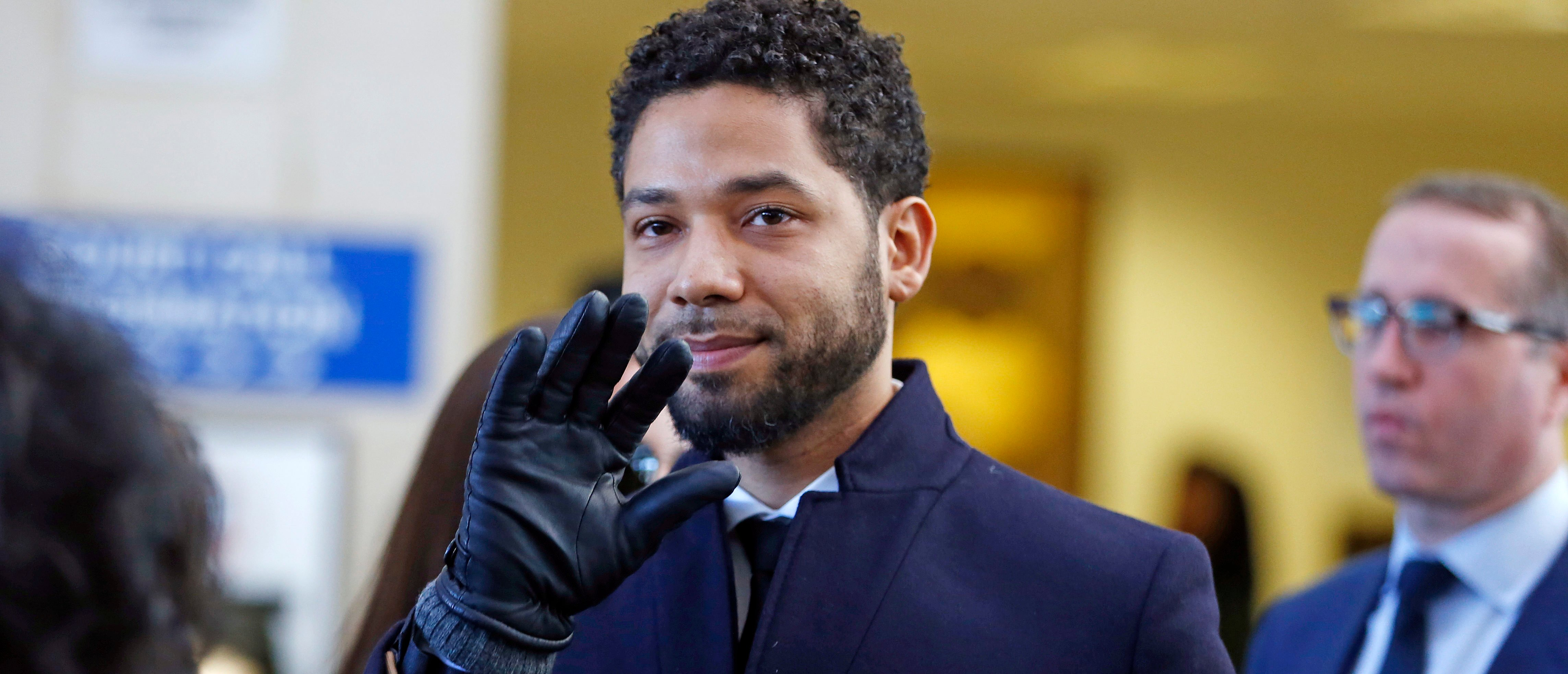 CHICAGO, ILLINOIS - MARCH 26: Actor Jussie Smollett waves as he follows his attorney to the microphones after his court appearance at Leighton Courthouse on March 26, 2019 in Chicago, Illinois. This morning in court it was announced that all charges were dropped against the actor. (Photo by Nuccio DiNuzzo/Getty Images)