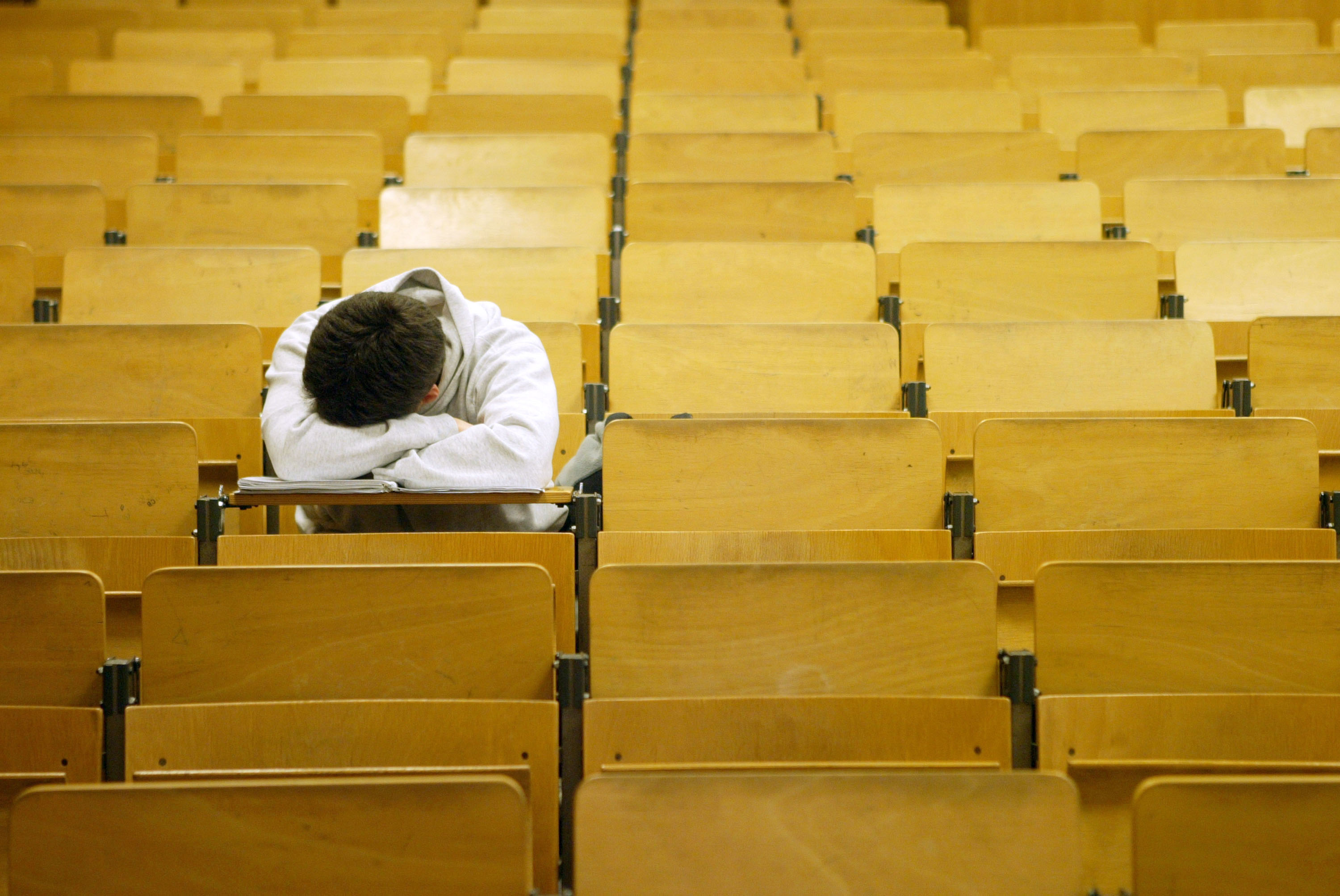 A student naps in a lecture hall at the Freie Universitaet (Photo by Sean Gallup/Getty Images)
