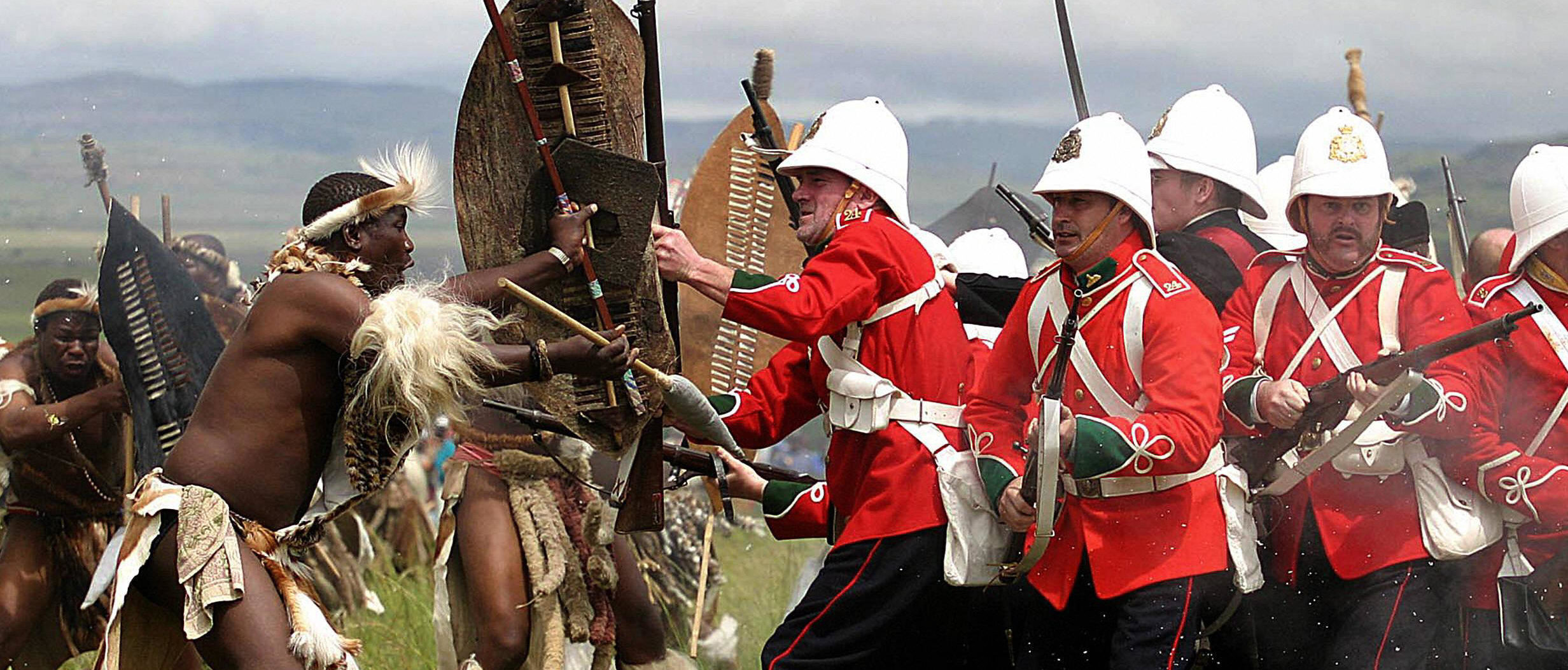 A group in British uniforms is assailed by Zulu warriors during the 125th Anniversary re-enactment of the battle of Isandlwana. AFP / Ajesh Jantilal