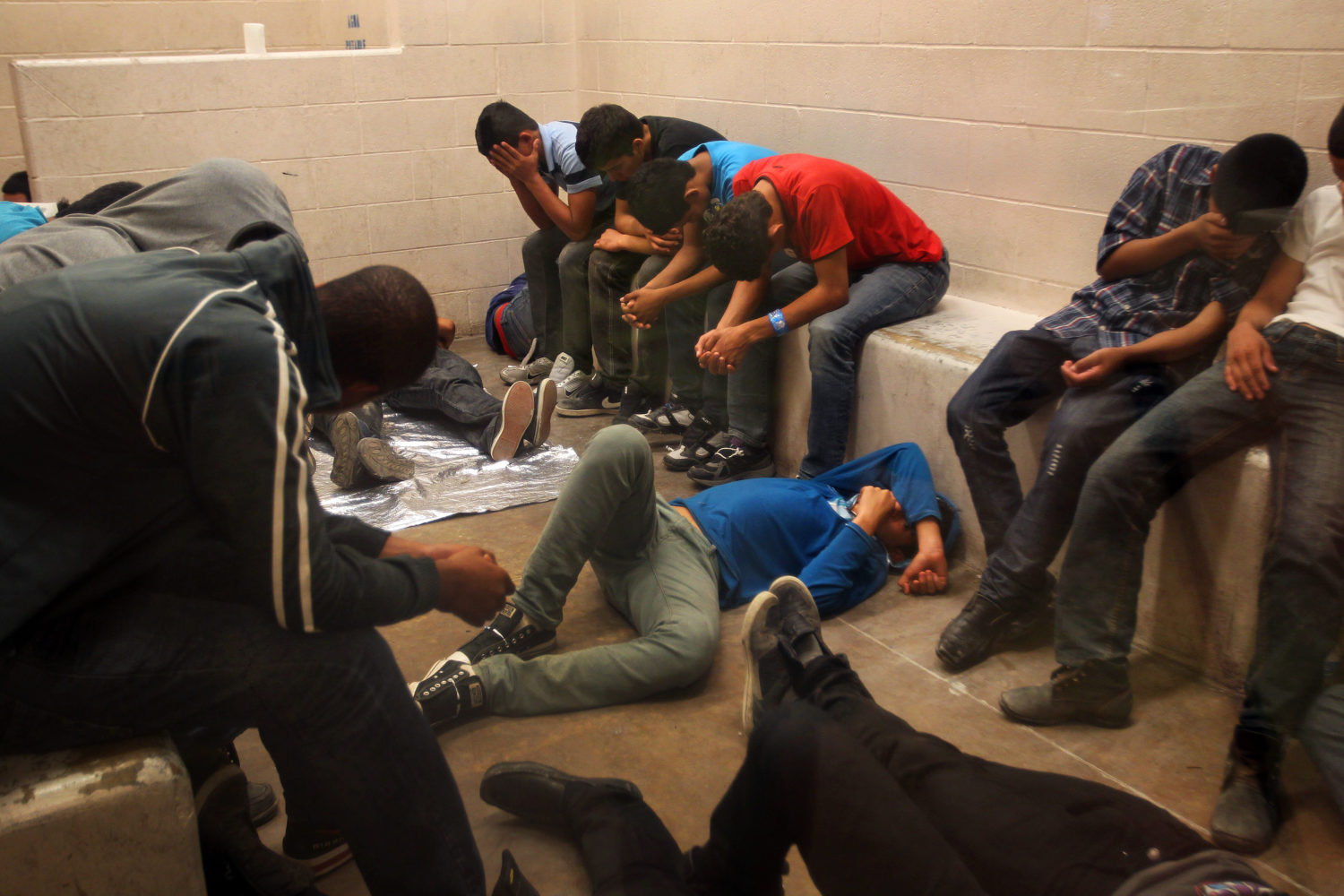 MCALLEN, TX - JULY 15: Immigrants who have been caught crossing the border illegally are housed inside the McAllen Border Patrol Station in McAllen, Texas where they are processed on July 15, 2014 in McAllen, Texas. The detainees are both men and women, and range in age from infants to adults, where more than 350 were being held. Detainees are mostly separated by gender and age, except for infants. (Pool photo by Rick Loomis-Pool/Getty Images)