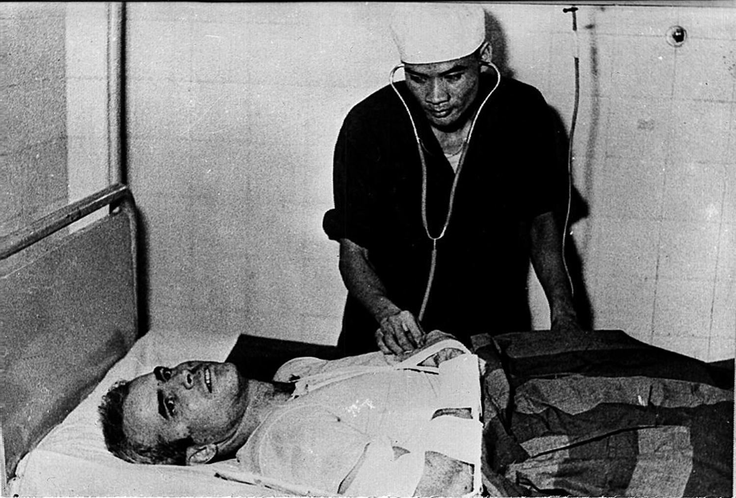 A photo taken in 1967 shows US Navy Airforce Major John McCain being examined by a Vietnamese doctor. (AFP/Getty Images)