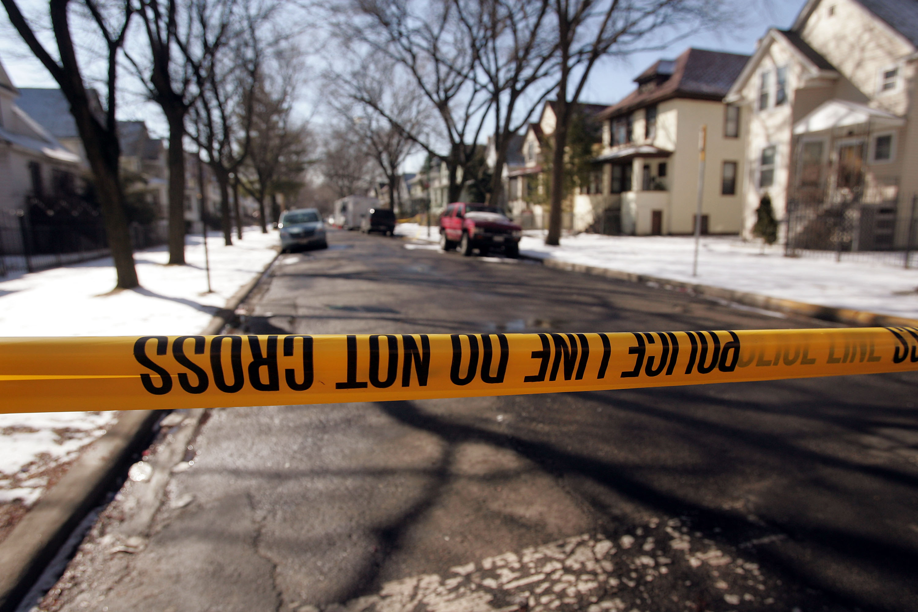 Crime-scene tape stops all but the residents ... (Photo by Scott Olson/Getty Images)