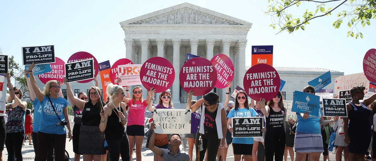 Protesters on both sides of the abortion issue rally. (Photo by Mark Wilson/Getty Images)