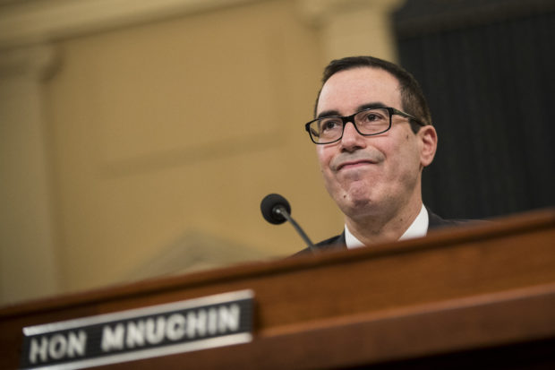 U.S. Secretary of Treasury Steve Mnuchin testifies during a House Ways and Means Committee hearing concerning the Trump administration's fiscal year 2018 budget proposals, on Capitol Hill, May 24, 2017 in Washington, DC. President Trump is proposing to cut $3.6 trillion in federal spending over the next 10 years while increasing spending on defense and border security. (Photo by Drew Angerer/Getty Images)