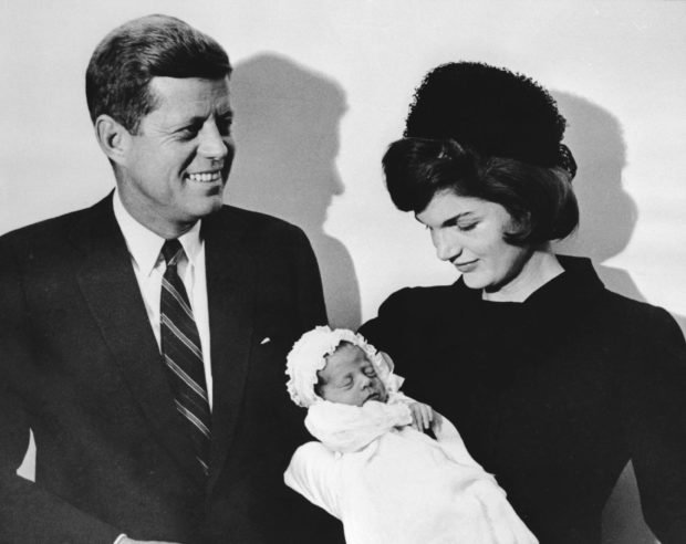 Picture taken 10 December 1960 showing John F. Kennedy and his wife Jacqueline holding their son John during the christening ceremony at the chapel of Georgetown university. Researchers found John F. Kennedy Jr body 21 July 1999 and wreckage from the plane he was piloting when it crashed in the Atlantic Ocean. / AFP PHOTO / SAM SCHULMAN (Photo credit should read SAM SCHULMAN/AFP/Getty Images)