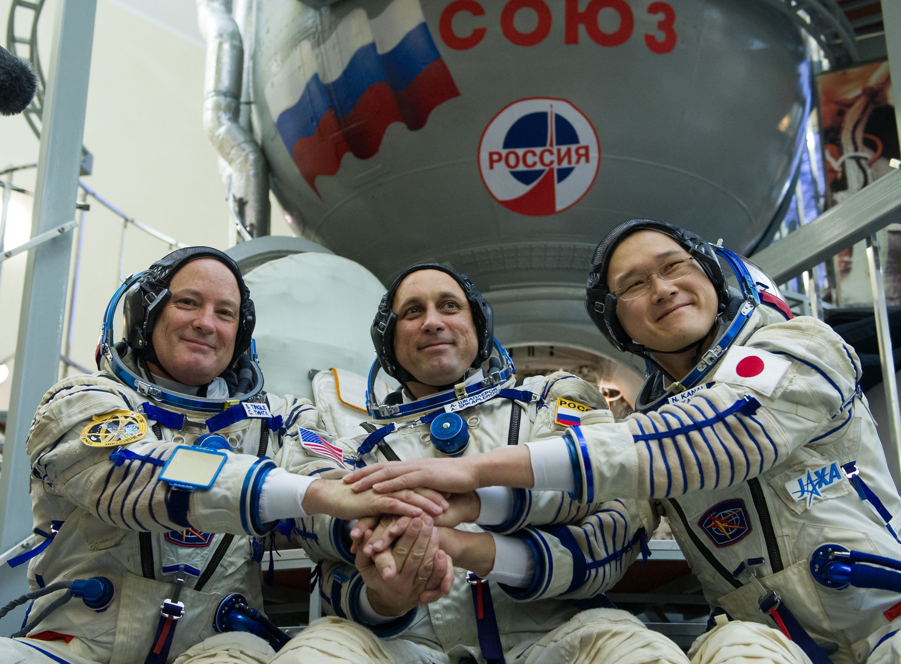 Members of the International Space Station (ISS) expedition 54/55, NASA astronaut Scott Tingle (L), Roscosmos cosmonaut Anton Shkaplerov (C) and Norishige Kanai of the Japan Aerospace Exploration Agency (JAXA) shake hands before their final exam at the Gagarin Cosmonauts' Training Centre in Star City outside Moscow on November 29, 2017. (STR/AFP/Getty Images)