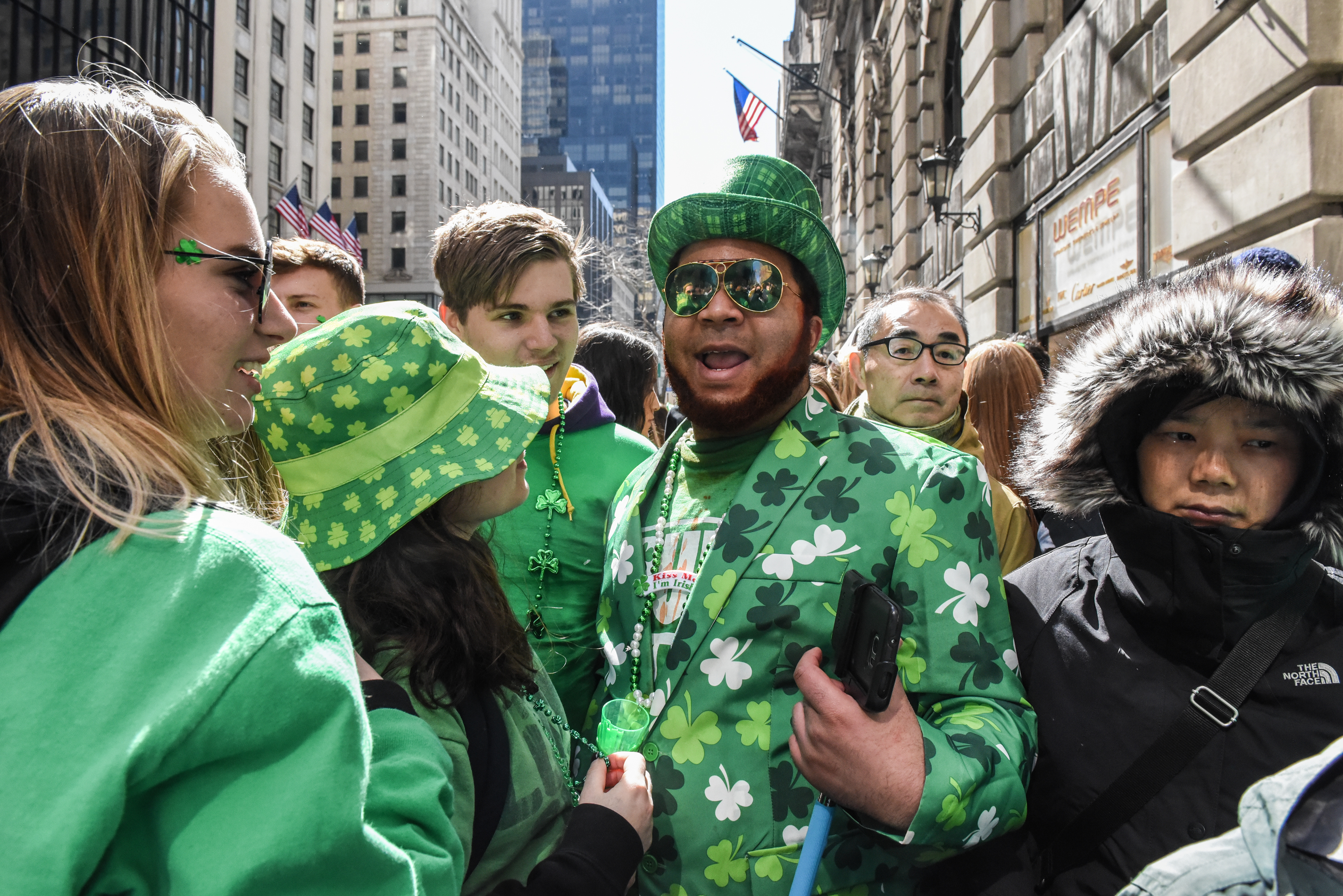 People participate on the sidelines of the annual St. Patrick's Day parade along 5th Ave. on March 17, 2018 in New York City. New York's Saint Patrick's Day parade is the largest in the world. (Photo by Stephanie Keith/Getty Images)