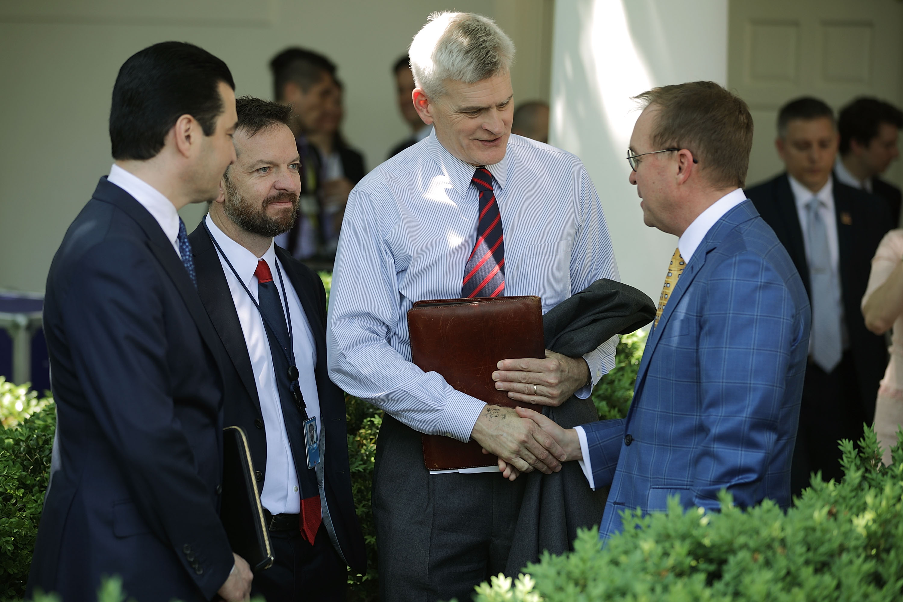 U.S. Food and Drug Administration Commissioner Scott Gottleib (L), Sen. Bill Cassidy (C) and Office of Management and Budget Director Mick Mulvaney (R) greet one another before an announcement by President Donald Trump about drug prices in the Rose Garden at the White House May 11, 2018 in Washington, DC. (Photo by Chip Somodevilla/Getty Images)