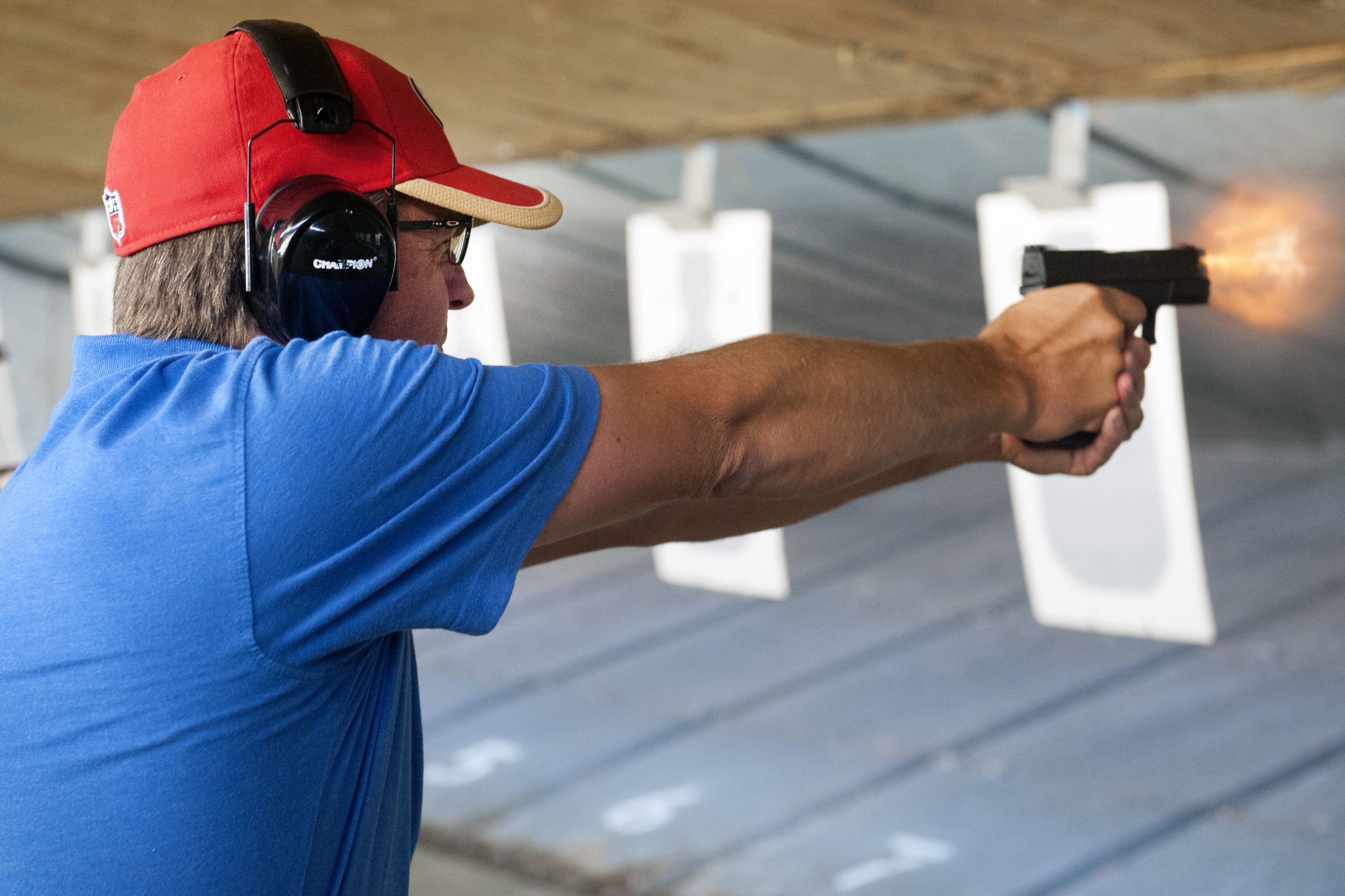 Wayne (last name not given), a facility maintenance employee with a central Colorado school, fires his gun during a firearms course for school teachers ... (JASON CONNOLLY/AFP/Getty Images)