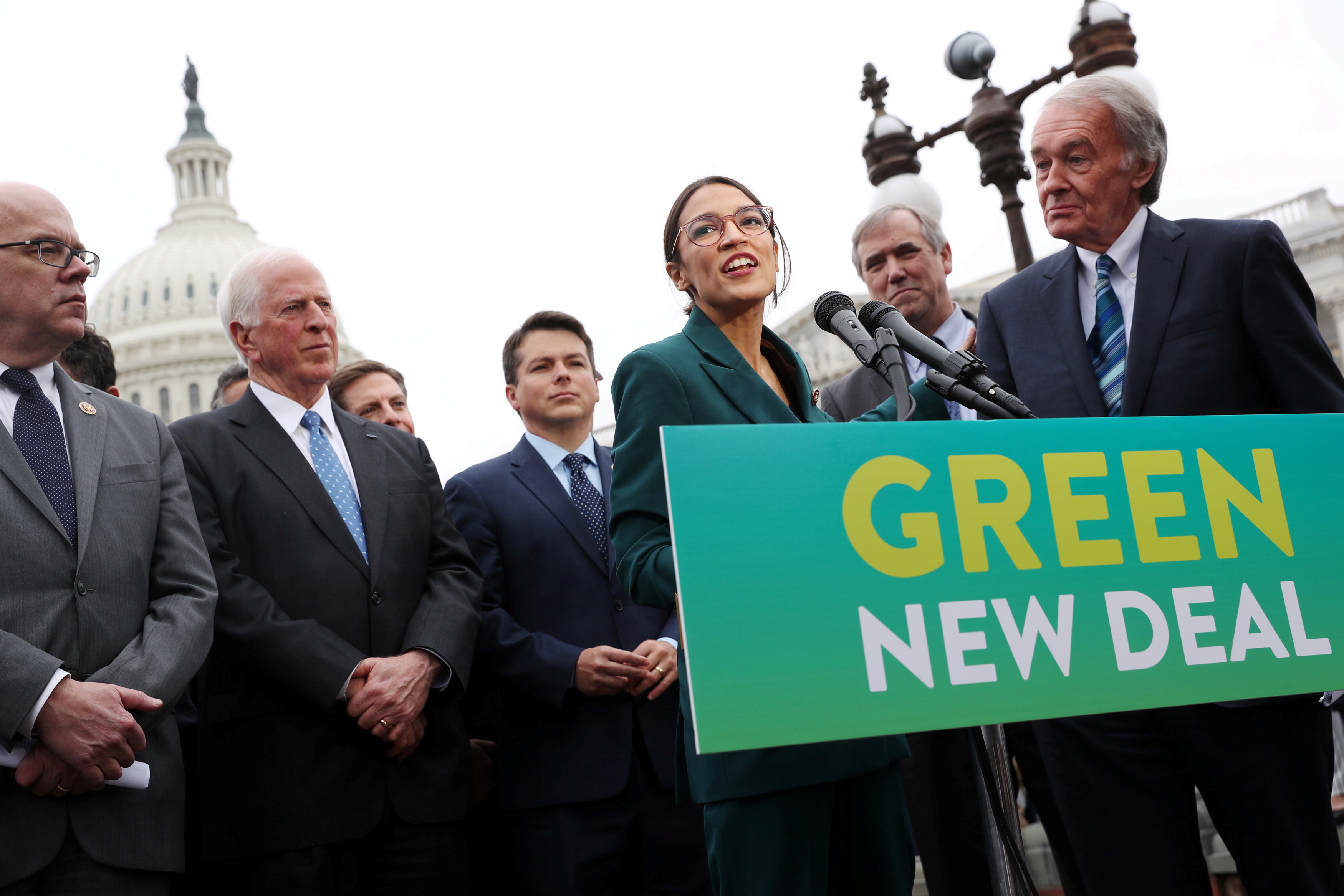 "U.S. Representative Alexandria Ocasio-Cortez and Senator Ed Markey hold a news conference for their proposed ""Green New Deal"" to achieve net-zero greenhouse gas emissions in 10 years, at the U.S. Capitol in Washington, U.S., Feb. 7, 2019. REUTERS/Jonathan Ernst"