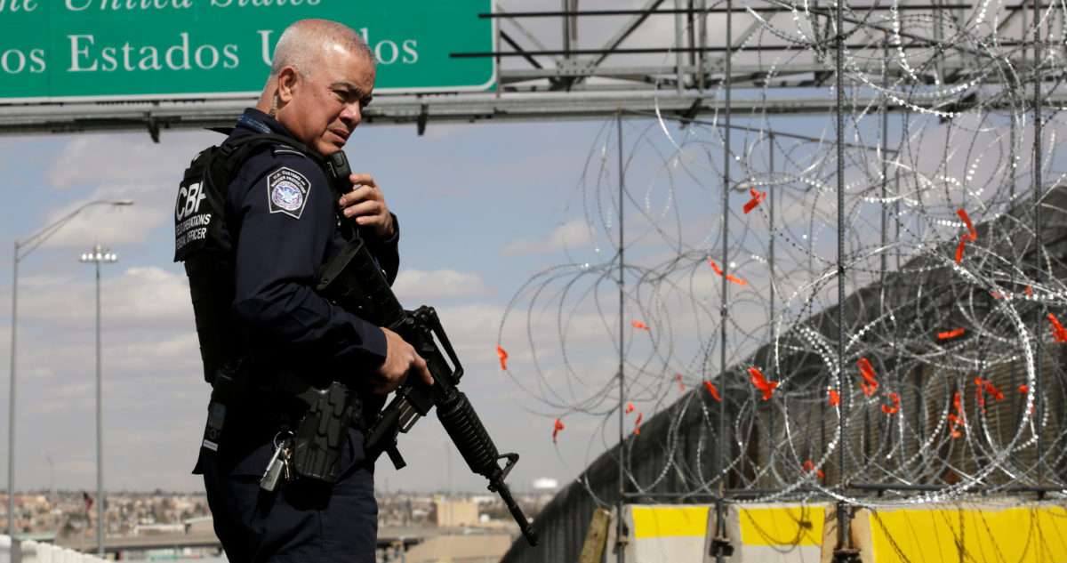 A U.S. Border and Customs and Border Protection (CBP) official stands next a concrete K-rail with concertina wire at Cordova-Americas bridge to enhance security efforts in preparation for increasing number of migrants arriving at the border, as seen from Ciudad Juarez, Mexico February 22, 2019. REUTERS/Jose Luis Gonzalez