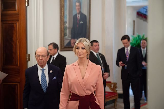 Senior White House advisor Ivanka Trump and Commerce Secretary Wilbur Ross (R) arrive for the first meeting of the American Workforce Policy Advisory Board with US President Donald Trump in the State Dining Room of the White House in Washington, DC, March 6, 2019. (Photo credit: SAUL LOEB/AFP/Getty Images)
