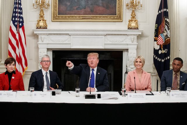 President Donald Trump delivers remarks beside Iowa Governor Kim Reynolds, far left, Apple CEO Tim Cook, left, Advisor Ivanka Trump, right, and Johnny C. Taylor, Jr., CEO of the Society for Human Resource Management, far right, during a meeting with the American Workforce Policy Advisory Board inside the State Dining Room of the White House on March 6, 2019 in Washington, DC. The board, co-chaired by Ivanka and Commerce Secretary Wilbur Ross, is tasked with developing a strategy to revamp the U.S. workforce for well-paid, in-demand jobs and with promoting private-sector investments in workers. (Photo by Tom Brenner/Getty Images)