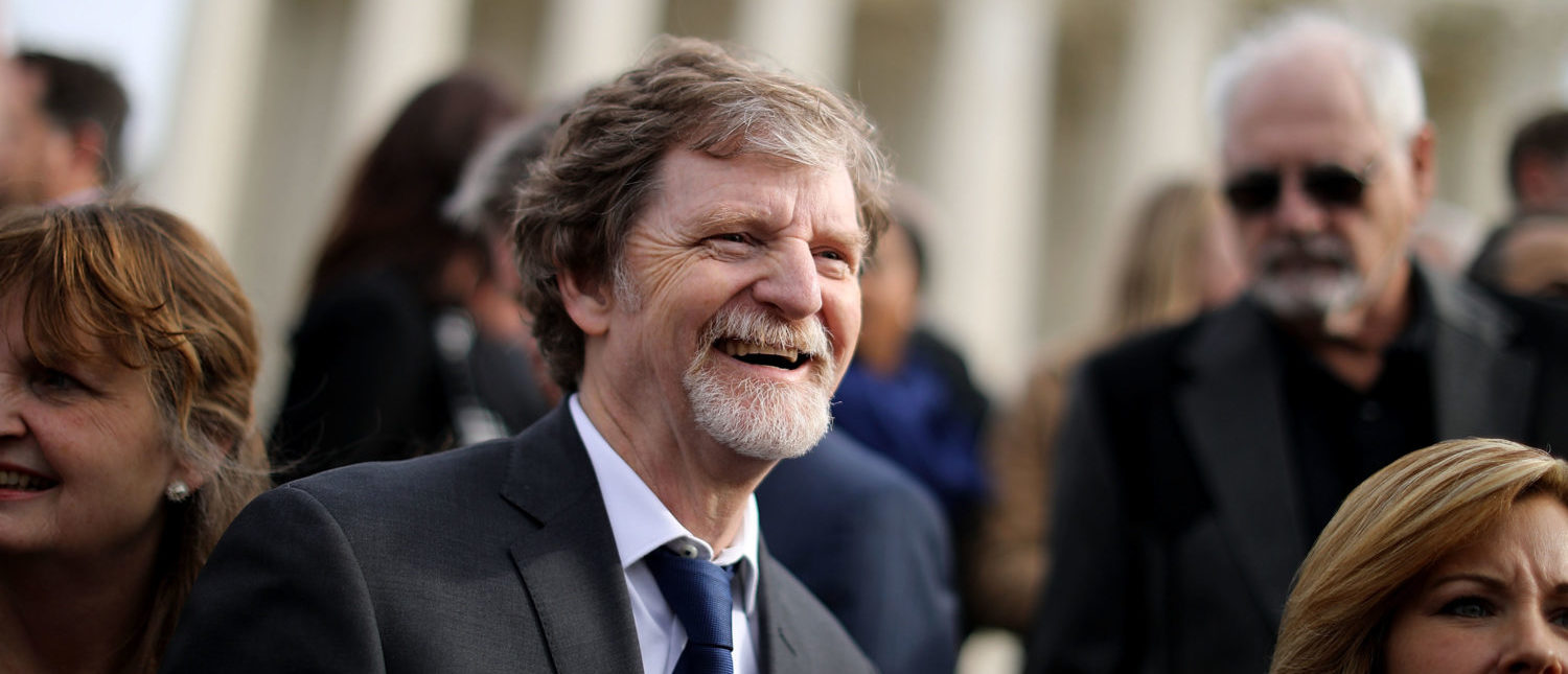 Christian baker Jack Phillips and members of his family and legal team pose for photographs in front of the Supreme Court after the court heard the case Masterpiece Cakeshop v. Colorado Civil Rights Commission on December 5, 2017. (Chip Somodevilla/Getty Images)