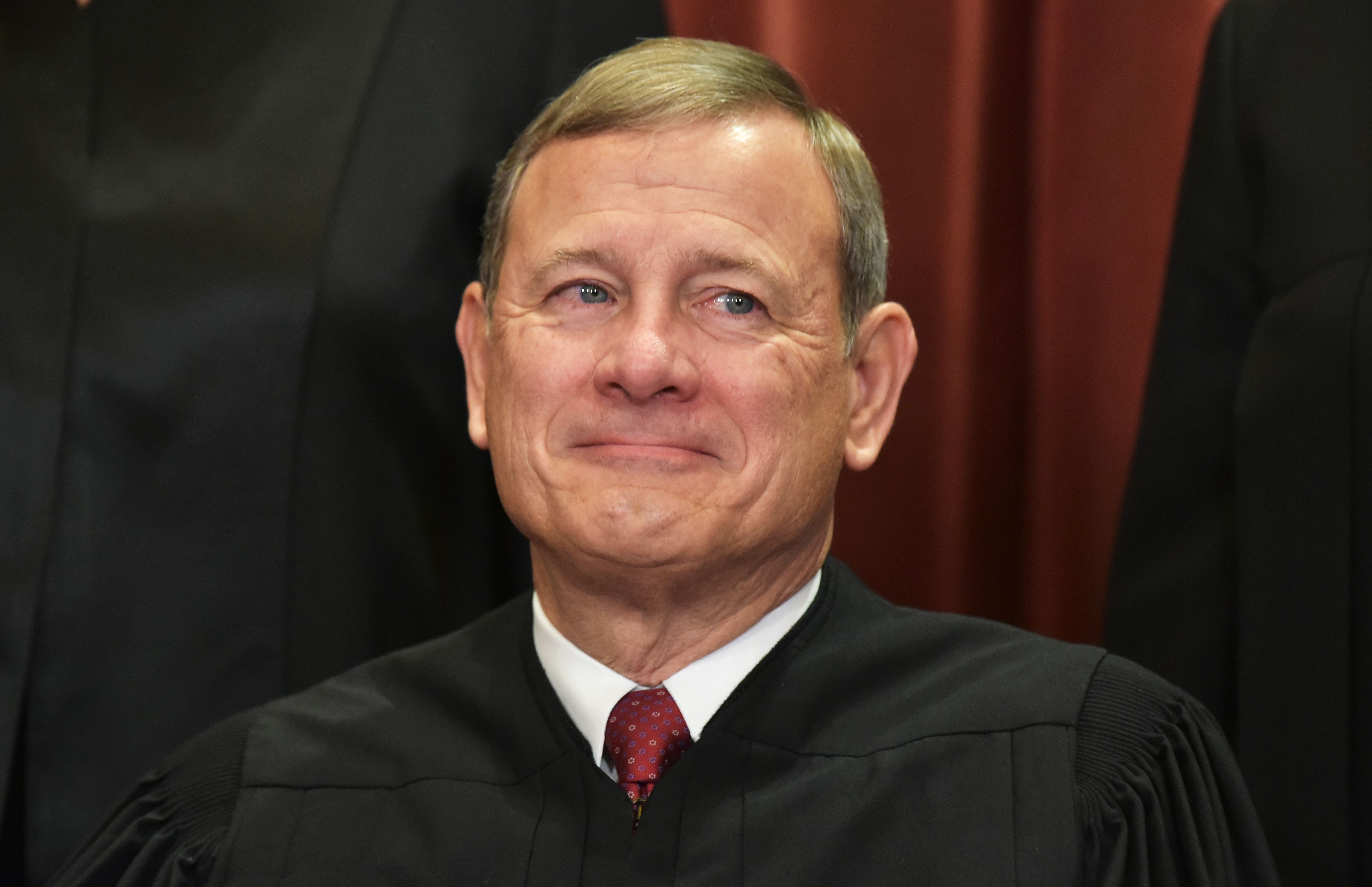 Chief Justice John Roberts poses for the official group photo on November 30, 2018. (Mandel Ngan/AFP/Getty Images)
