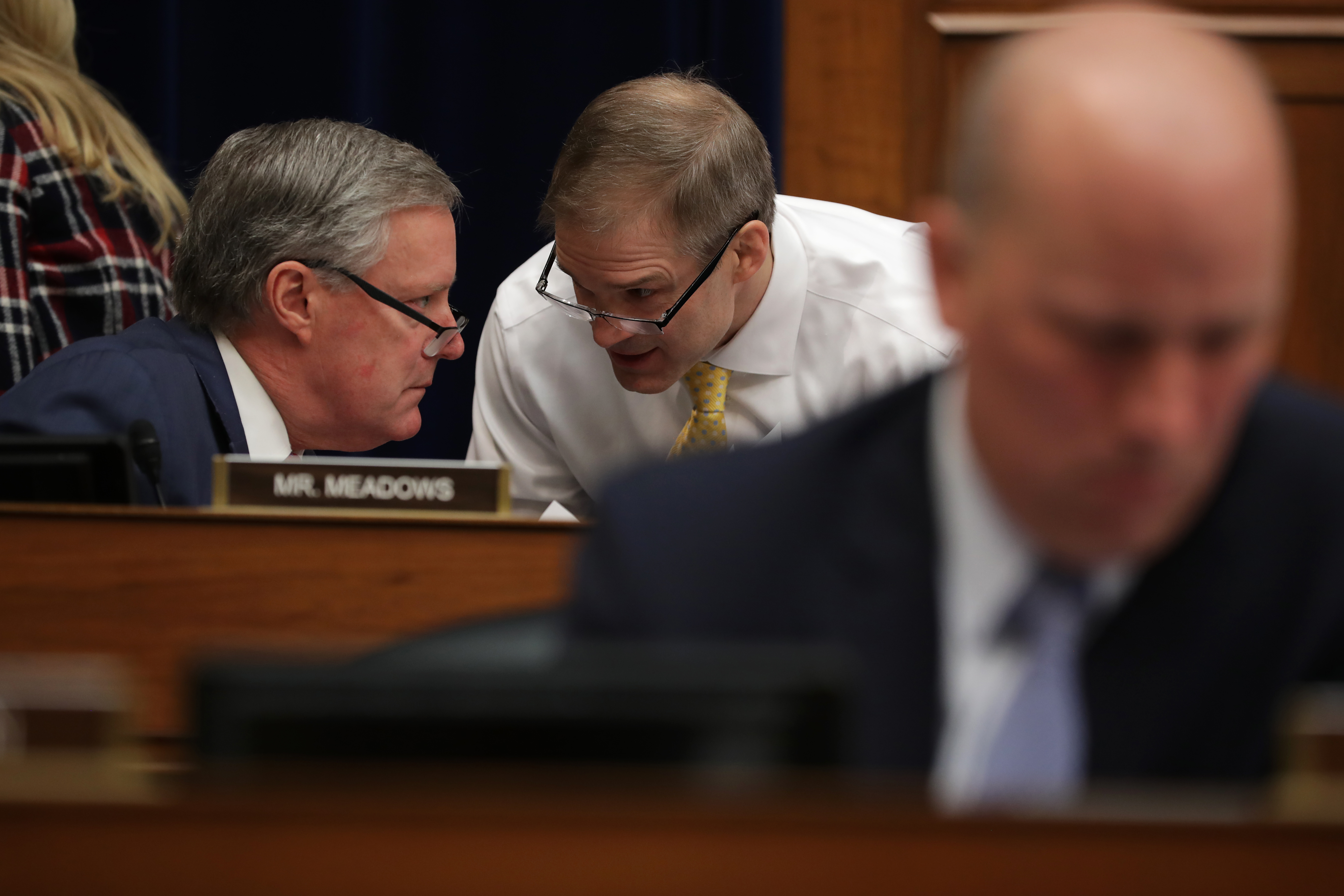 WASHINGTON, DC - FEBRUARY 27: Rep. Jim Jordan (R-OH) (R) and Rep. Mark Meadows (R-NC) talk during testimony by Michael Cohen, former attorney and fixer for President Donald Trump before the House Oversight Committee on Capitol Hill February 27, 2019 in Washington, DC. (Photo by Chip Somodevilla/Getty Images)