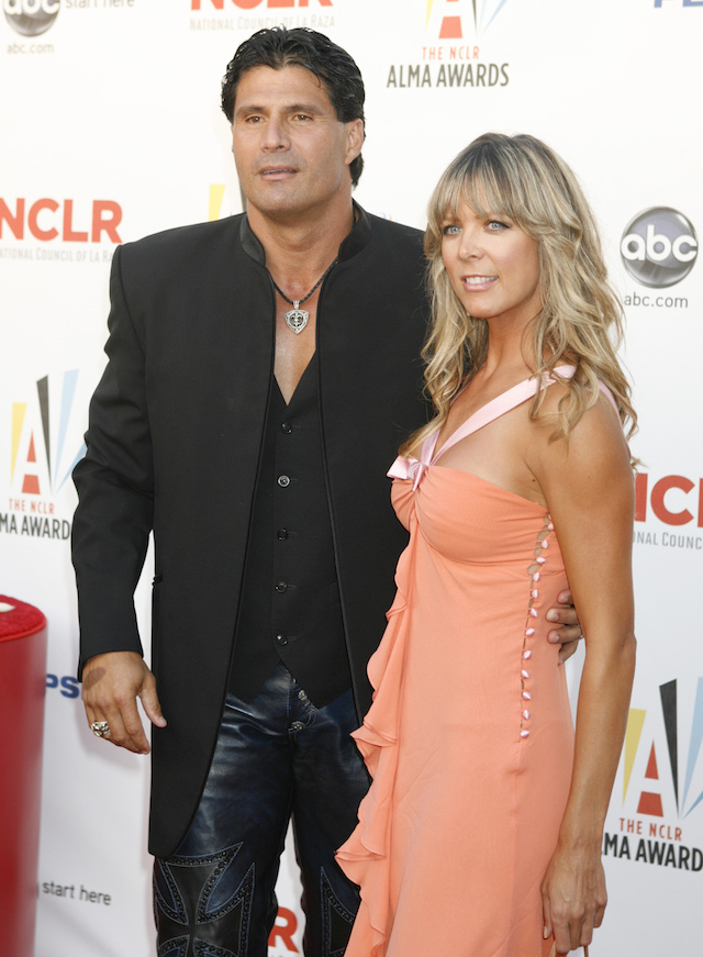 Former baseball player Jose Canseco and actress Melissa Biggs arrive at a taping of the 2009 ALMA Awards sponsored by the National Council of La Raza in Los Angeles September 17, 2009. REUTERS/Fred Prouser