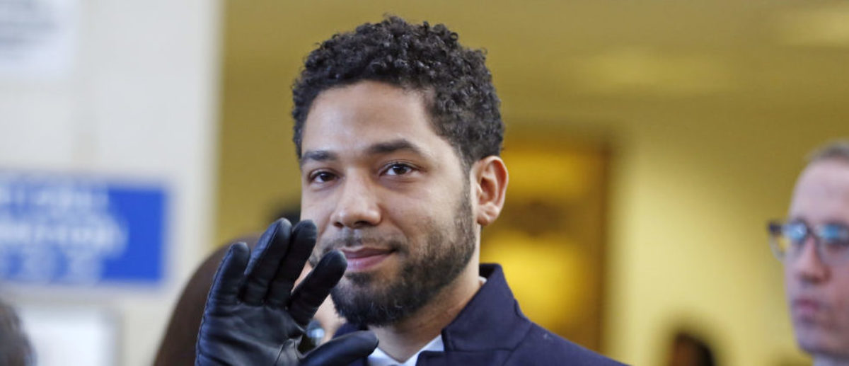 Actor Jussie Smollett waves as he follows his attorney to the microphones after his court appearance at Leighton Courthouse on March 26, 2019 in Chicago, Illinois. This morning in court it was announced that all charges were dropped against the actor. (Photo by Nuccio DiNuzzo/Getty Images)