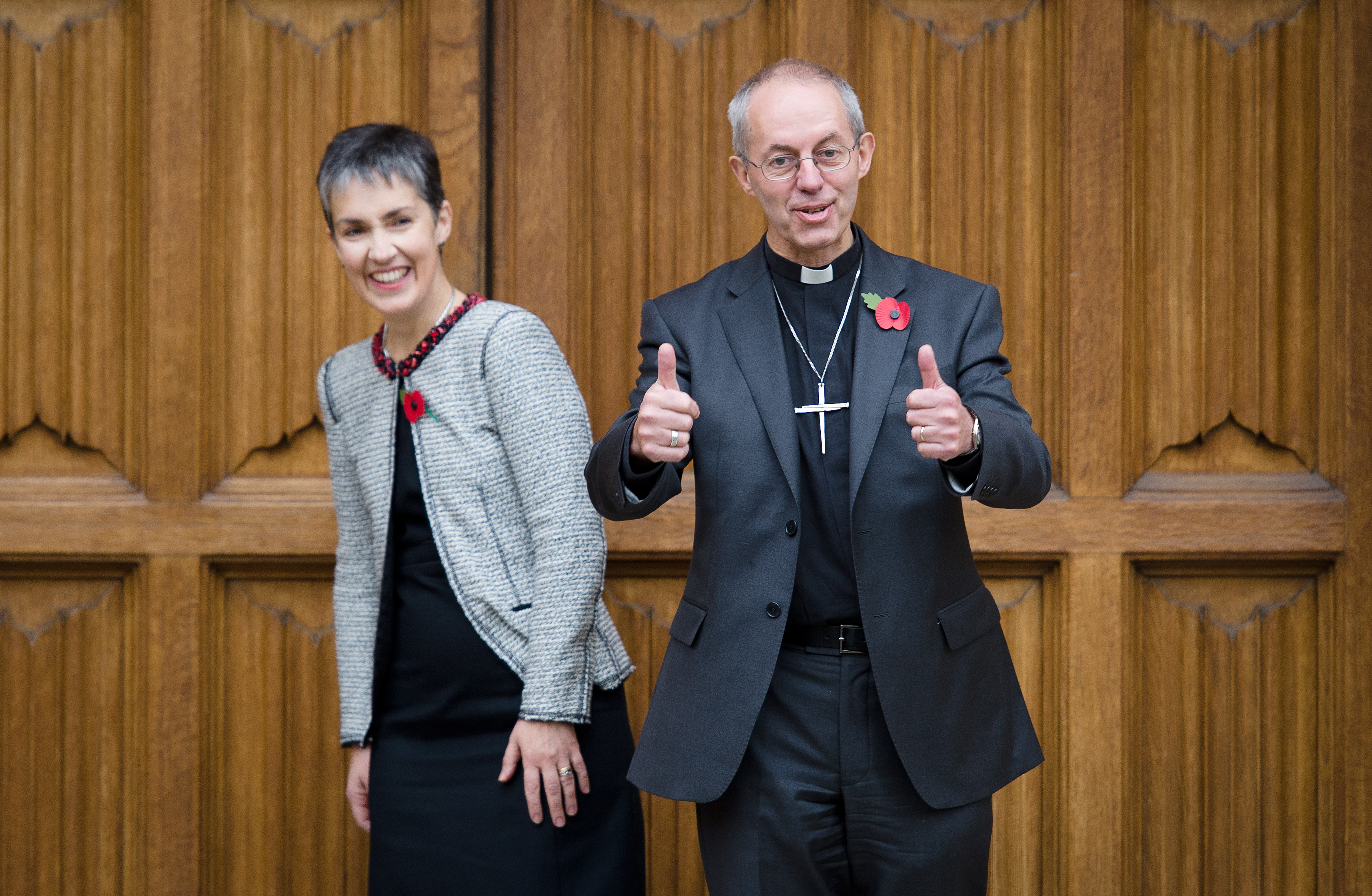 The new Archbishop of Canterbury Justin Welby (R) poses for pictures with his wife Caroline following a press conference in London, on November 9, 2012. (LEON NEAL/AFP/Getty Images)