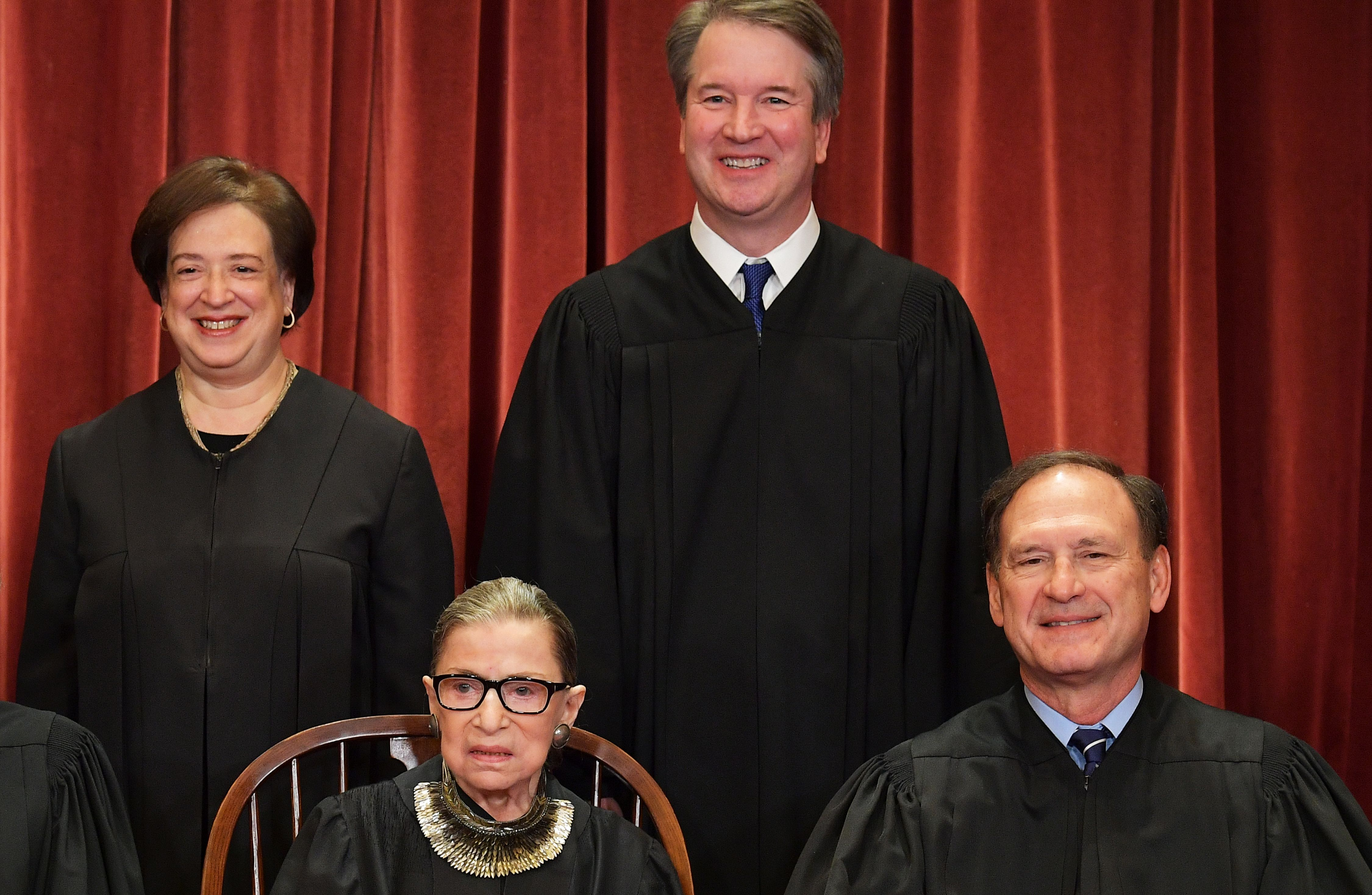 Justice Elena Kagan (L, rear), Justice Brett Kavanaugh (C, rear), Justice Ruth Bader Ginsburg (C, front) and Justice Samuel Alito pose for the Supreme Court official group photo on November 30, 2018. (Mandel Ngan/AFP/Getty Images)
