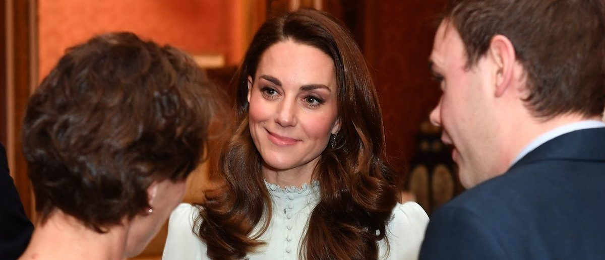 Britain's Catherine, Duchess of Cambridge (C), talks with guests as she attends a reception to mark the 50th Anniversary of the investiture of The Prince of Wales at Buckingham Palace in London on March 5, 2019. - The Queen hosted a reception to mark the Fiftieth Anniversary of the investiture of Britain's Prince Charles, her son, as the Prince of Wales. Prince Charles was created The Prince of Wales aged 9 on July 26th 1958 and was formally invested with the title by Her Majesty The Queen on July 1st 1969 at Caernarfon Castle. (Photo credit: DOMINIC LIPINSKI/AFP/Getty Images)