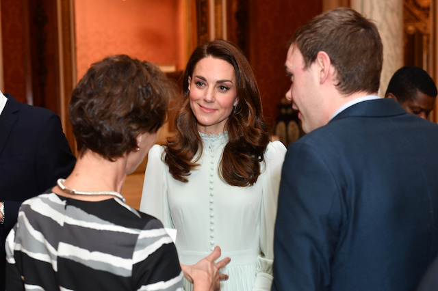 Britain's Catherine, Duchess of Cambridge speaks with guests at a reception to mark the fiftieth anniversary of the investiture of the Prince of Wales at Buckingham Palace in London, Britain March 5, 2019. Dominic Lipinski/Pool via REUTERS