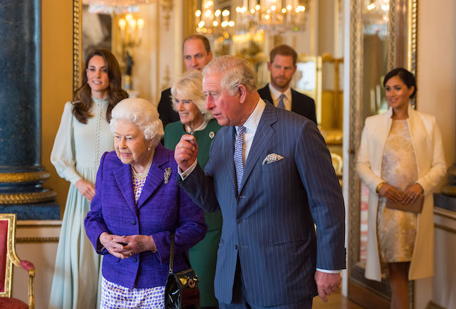 Britain's Catherine, Duchess of Cambridge, Britain's Queen Elizabeth II, Britain's Prince William, Duke of Cambridge, Britain's Camilla, Duchess of Cornwall, Britain's Prince Charles, Prince of Wales, Britain's Prince Harry, Duke of Sussex, and Britain's Meghan, Duchess of Sussex attend a reception to mark the 50th Anniversary of the investiture of The Prince of Wales at Buckingham Palace in London on March 5, 2019. - The Queen hosted a reception to mark the Fiftieth Anniversary of the investiture of Britain's Prince Charles, her son, as the Prince of Wales. Prince Charles was created The Prince of Wales aged 9 on July 26th 1958 and was formally invested with the title by Her Majesty The Queen on July 1st 1969 at Caernarfon Castle. (Photo credit: DOMINIC LIPINSKI/AFP/Getty Images)