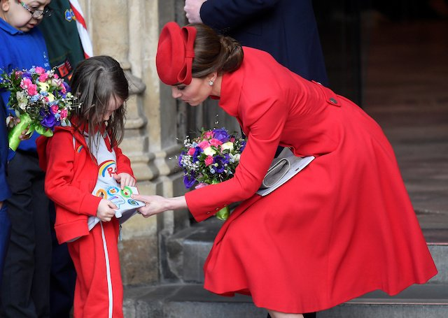 Britain's Catherine, Duchess of Cambridge reacts with a child after the Commonwealth Service at Westminster Abbey, on Commonwealth Day, in London, Britain March 11, 2019. REUTERS/Toby Melville