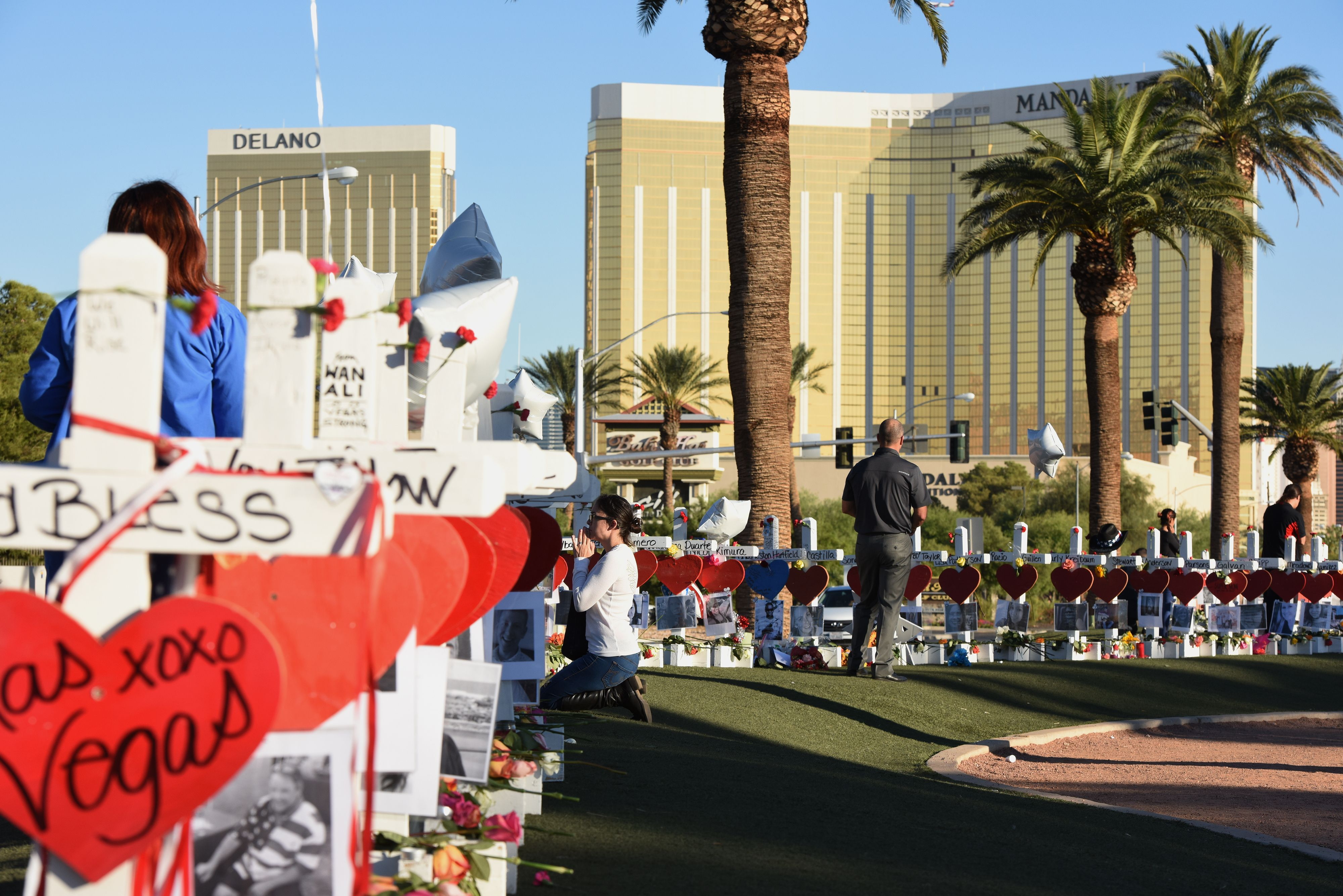 A woman prays beside 58 white crosses for the victims of the mass shooting on the Las Vegas Strip just south of the Mandalay Bay hotel, October 6, 2017. (Robyn Beck/AFP/Getty Images)