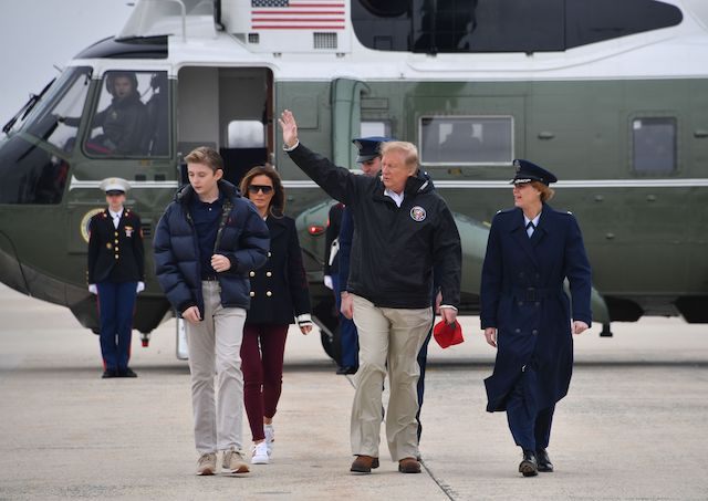 US President Donald Trump (C), with First Lady Melania Trump (L rear) and their son Barron (L), arrive to board Air Force One at Joint Base Andrews, in Maryland, on March 8, 2019 in Washington, DC. - Trump is heading to Alabama to survey tornado damage before spending the weekend at his Mar-a-Lago resort in Florida. (Photo credit: NICHOLAS KAMM/AFP/Getty Images)