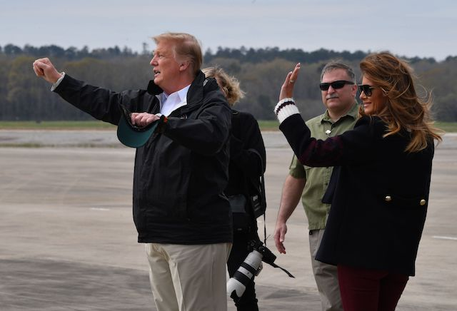 US President Donald Trump and first lady Melania Trump arrive at Fort Benning, Georgia, March 8, 2019 en route to areas in Alabama affected by recent tornado damage. (Photo credit: NICHOLAS KAMM/AFP/Getty Images)