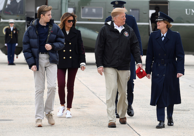 U.S. President Donald Trump, son Barron and First Lady Melania Trump walk to Air Force One as they prepare to depart from Joint Base Andrews, Maryland, to visit tornado-devastated Alabama, March 8, 2019. REUTERS/Mike Theiler