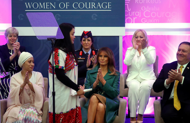 First lady Melania Trump applauds Naw Kínyaw Paw, a peace activist and General Secretary of the Karen Womenís Organization (KWO), after she spoke during the International Women of Courage (IWOC) celebration at the State Department in Washington, U.S., March 7, 2019. REUTERS/Kevin Lamarque