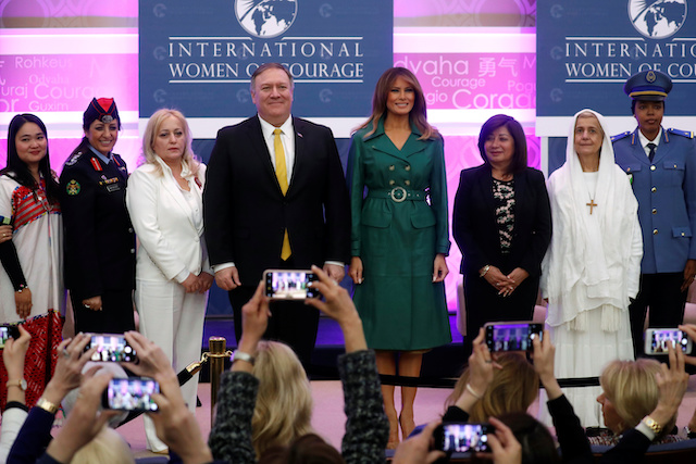 U.S. first lady Melania Trump and Secretary of State Mike Pompeo pose with award recipients during the International Women of Courage (IWOC) celebration at the State Department in Washington, U.S., March 7, 2019. REUTERS/Kevin Lamarque