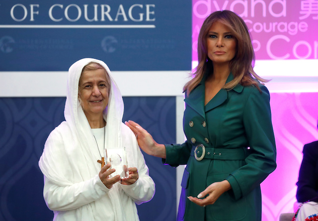 First lady Melania Trump presents an award to Mama Maggie of Egypt during the International Women of Courage (IWOC) celebration at the State Department in Washington, U.S., March 7, 2019. REUTERS/Kevin Lamarque