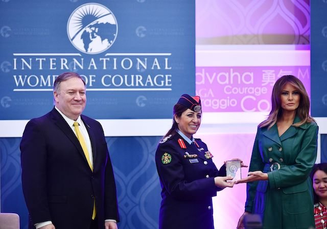 US First Lady Melania Trump (R) and Secretary of State Mike Pompeo (L) present the 2019 International Women of Courage award to Colonel Khalida Khalaf Hanna al-Twal of Jordan during a ceremony at the State Department in Washington, DC on March 7, 2019. (Photo credit: MANDEL NGAN/AFP/Getty Images)
